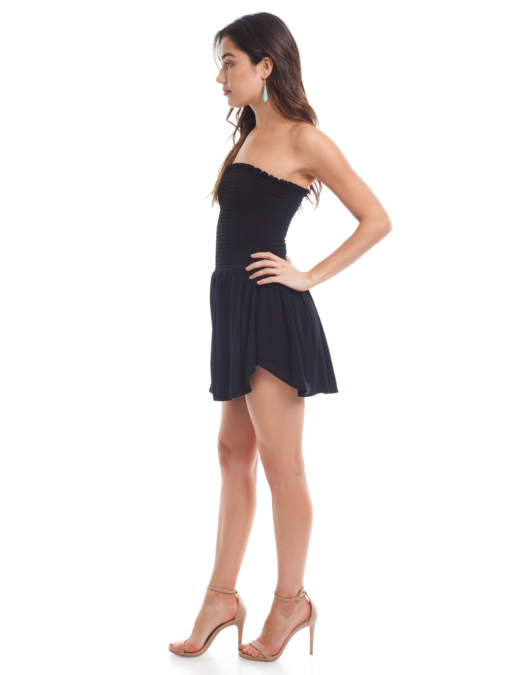 Woman wearing a romper rental from Blue Life called Dance Till Dawn Romper