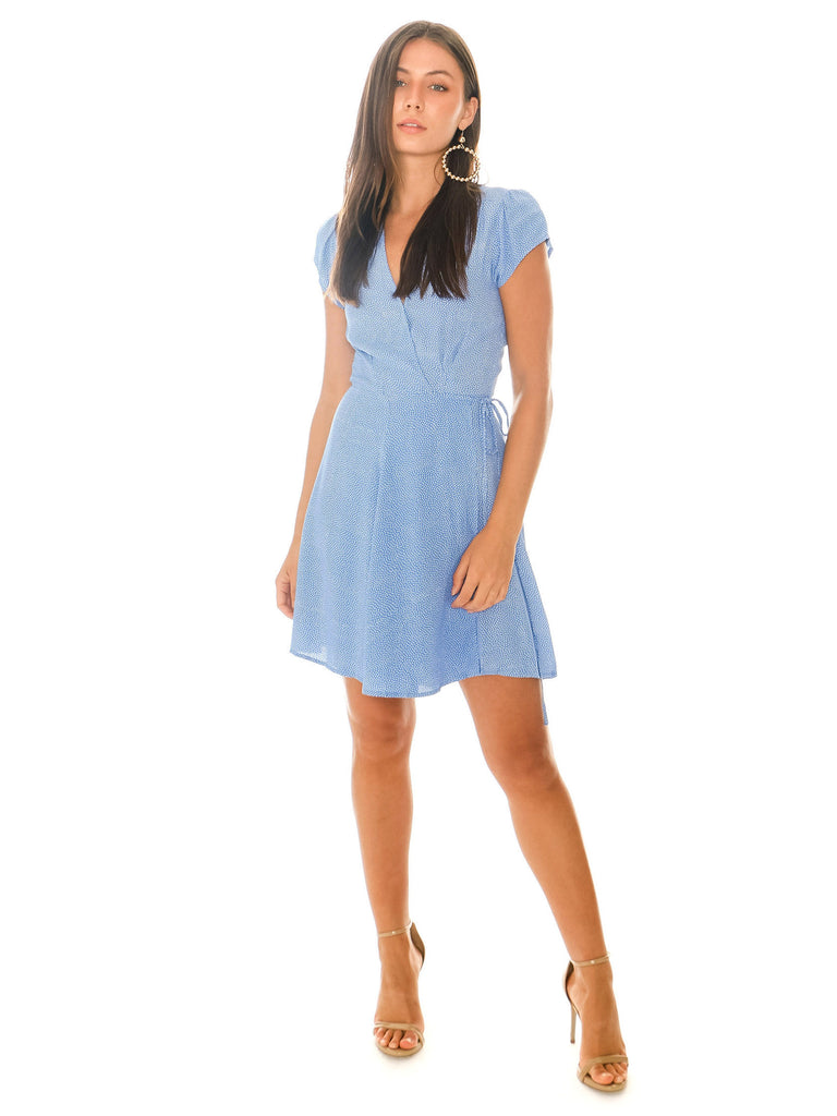 Women wearing a dress rental from ROLLAS called Ruffle Cold Shoulder Dress