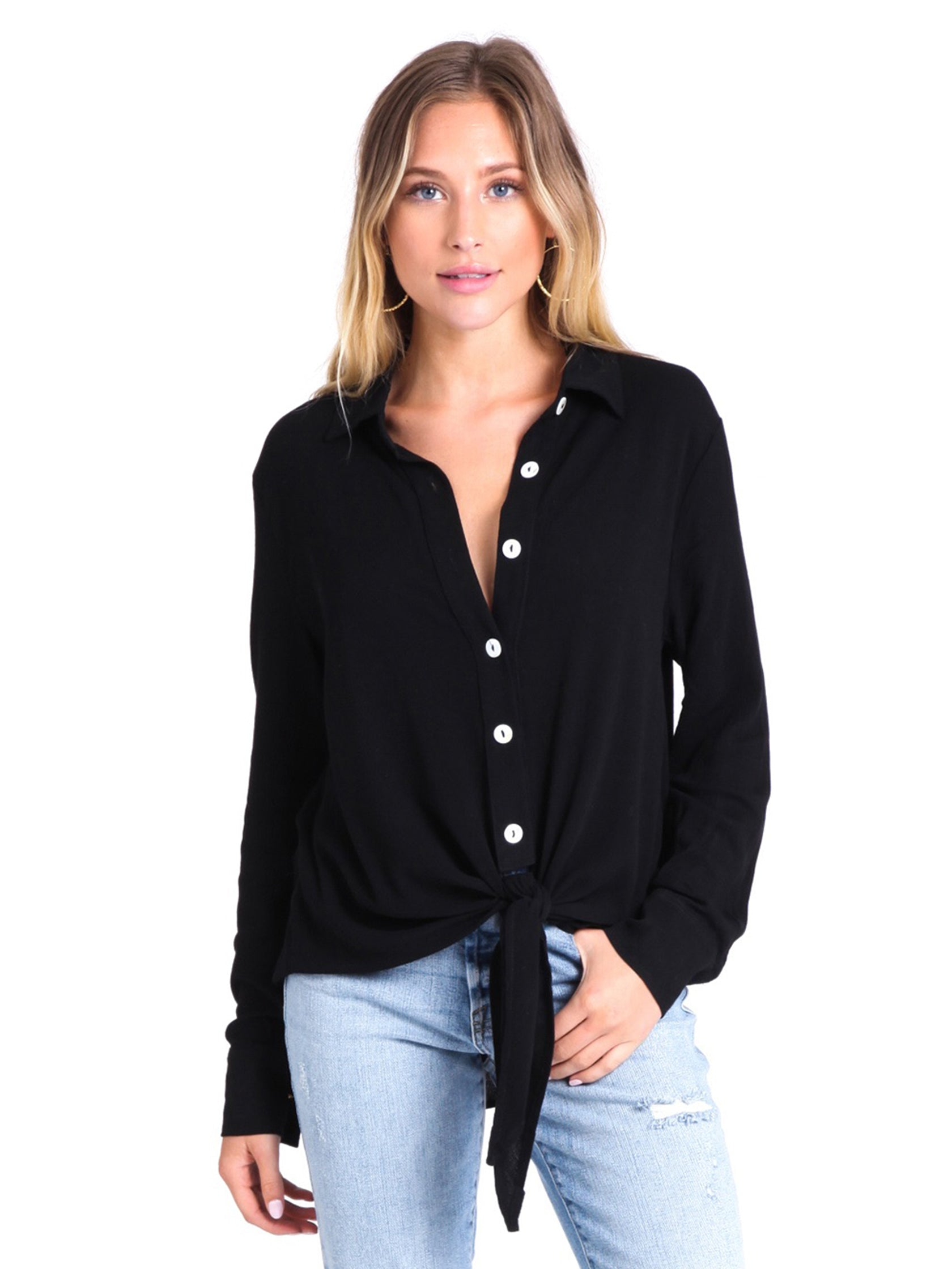 Woman wearing a top rental from FashionPass called Danielle Button Down Top