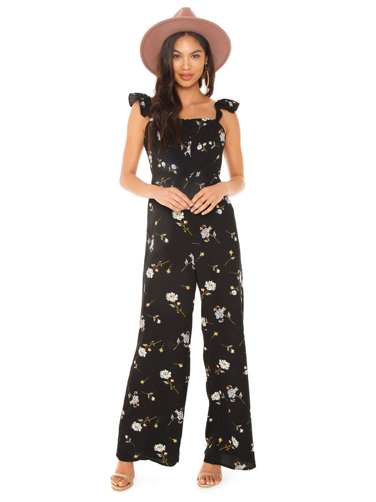 Woman wearing a jumpsuit rental from Line & Dot called Jasper Fringe Sweater
