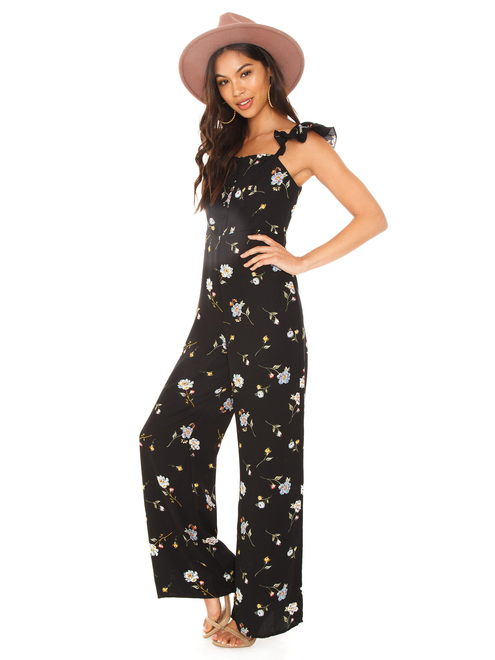 Woman wearing a jumpsuit rental from Line & Dot called Darcey Jumpsuit