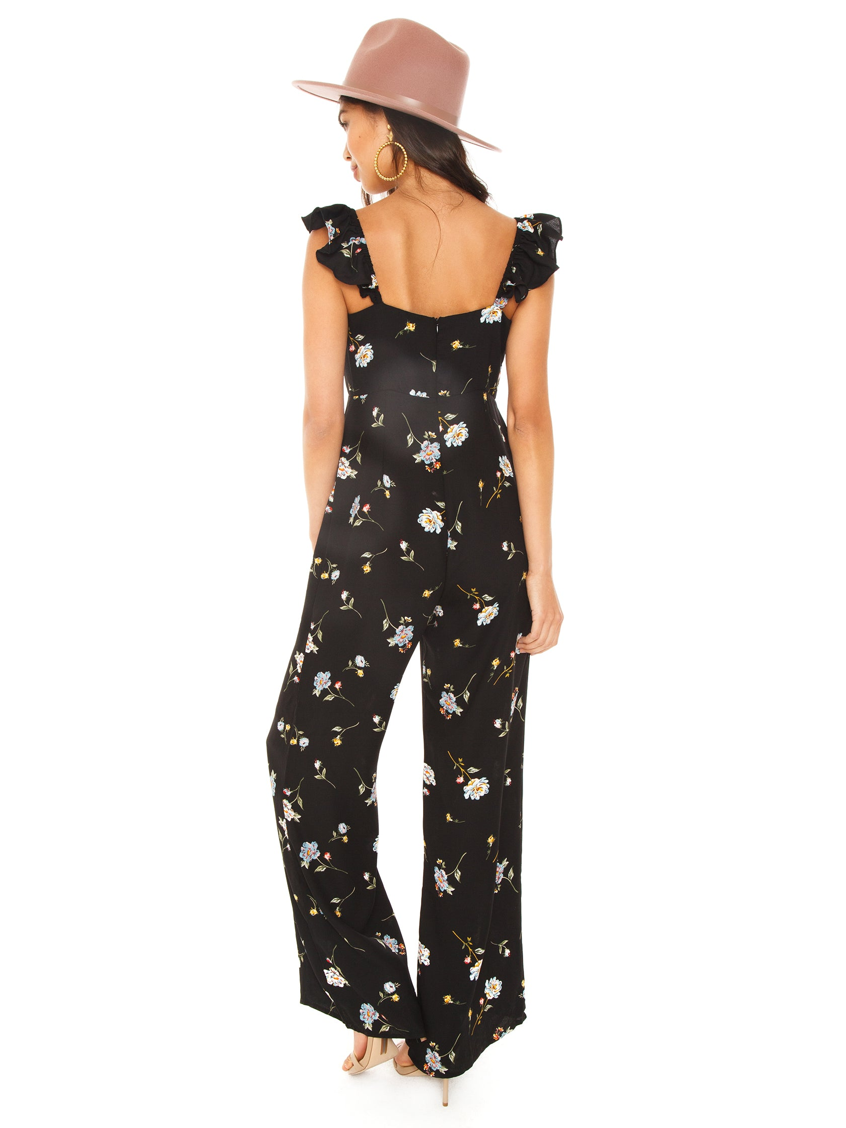Women wearing a jumpsuit rental from Line & Dot called Darcey Jumpsuit