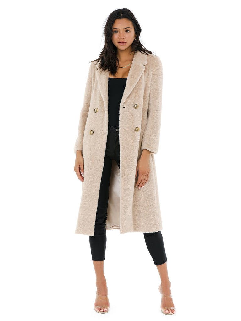 Women wearing a jacket rental from ASTR called Daria Midi Coat