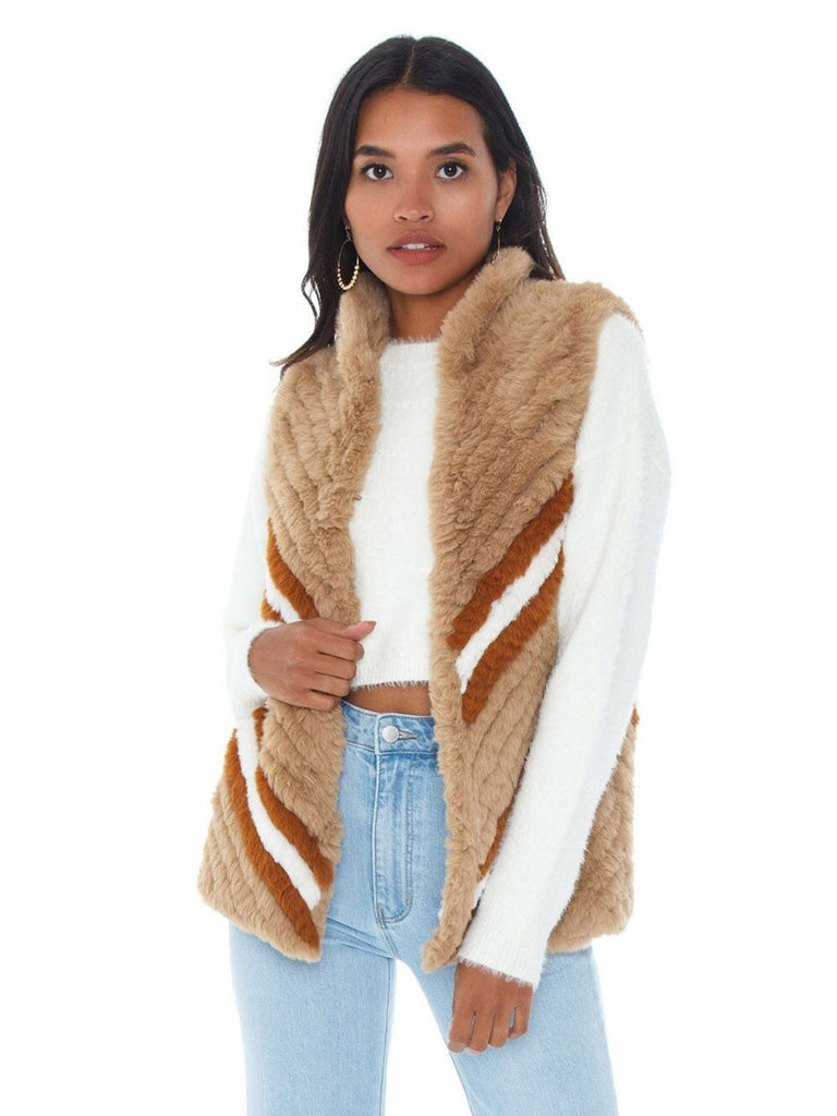 Girl wearing a jacket rental from Heartloom called Heidi Faux Fur Jacket