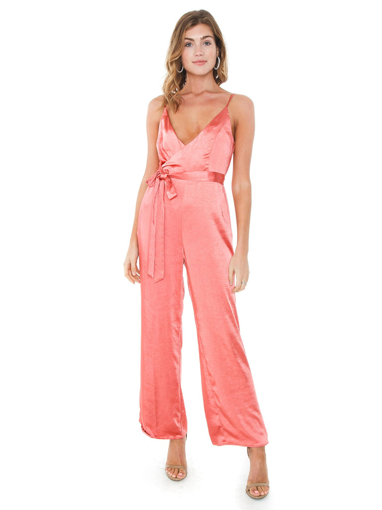 Women wearing a jumpsuit rental from Line & Dot called Jasper Fringe Sweater