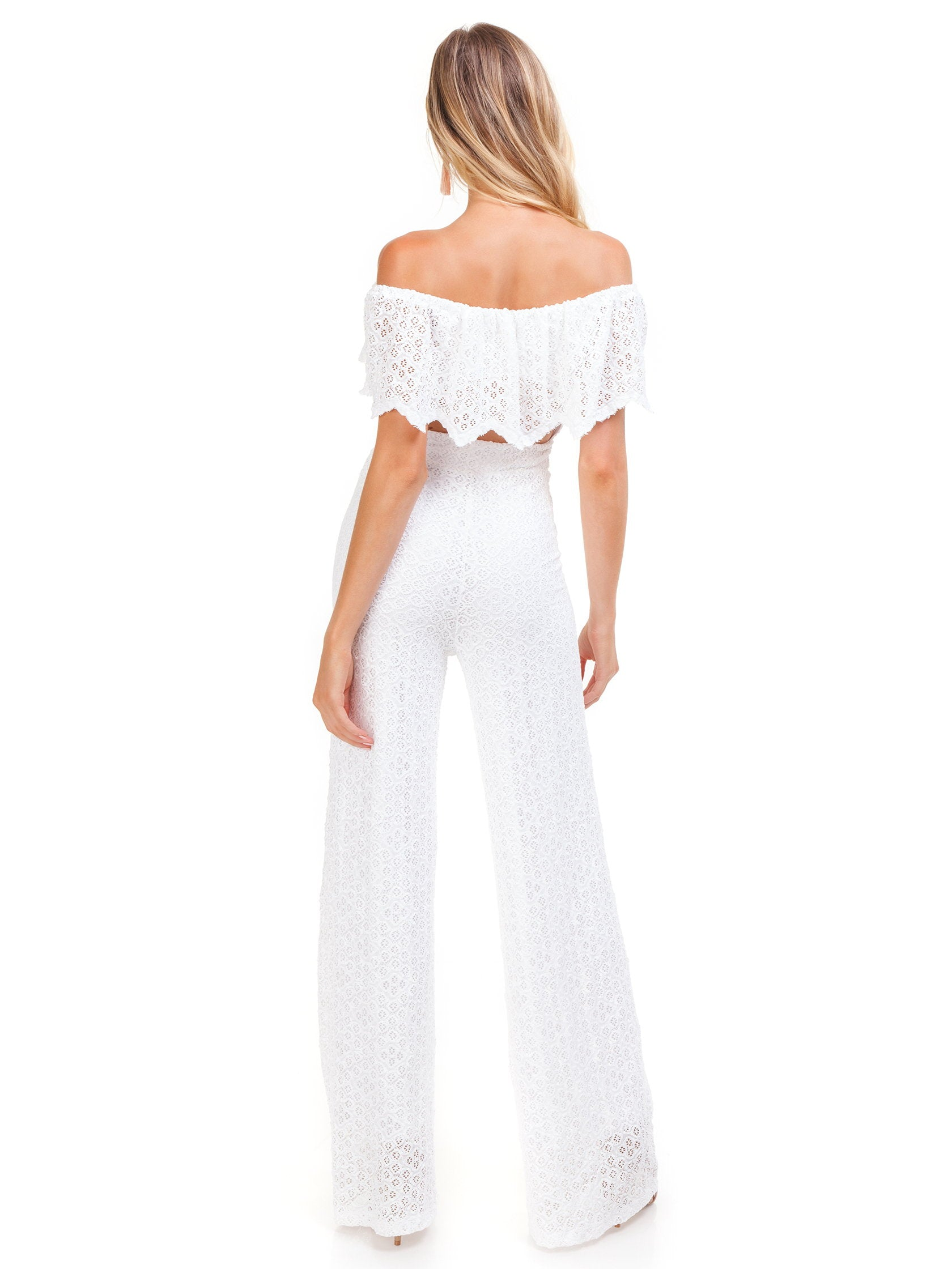 Women wearing a jumpsuit rental from Nightcap Clothing called Diamond Lace Positano Jumpsuit