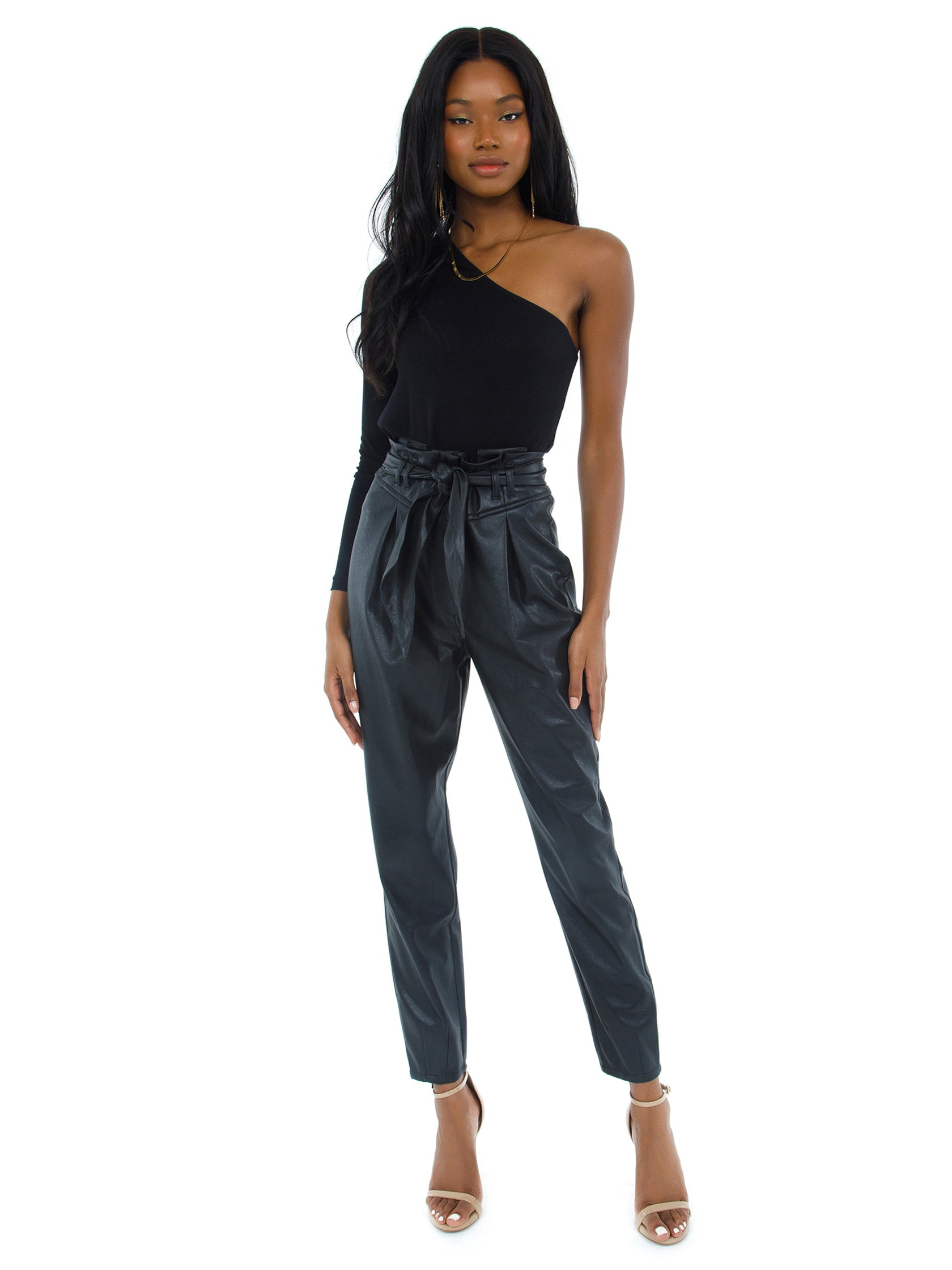 Women wearing a pants rental from For Love & Lemons called Dillon High Waist Pant