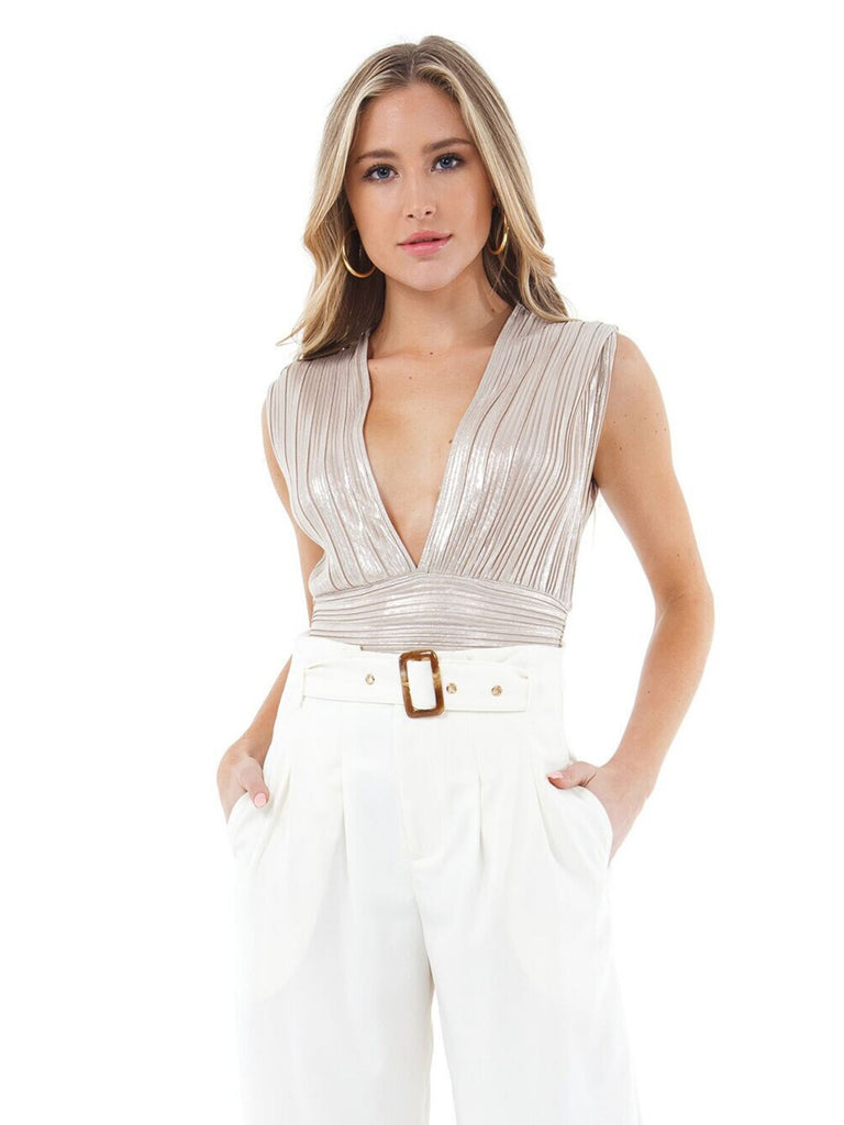 Woman wearing a top rental from BARDOT called Surplice Jumpsuit