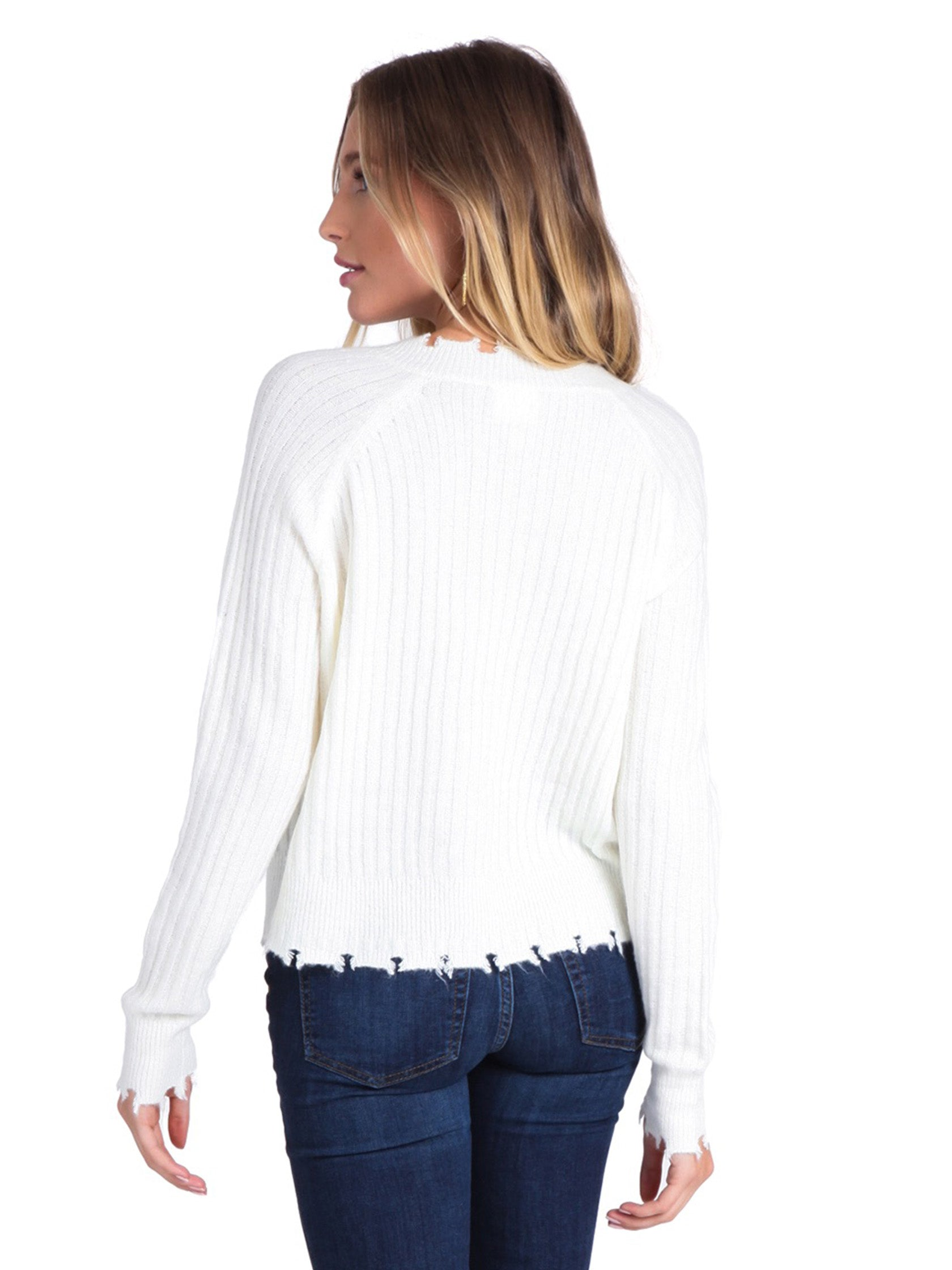 Women outfit in a sweater rental from FashionPass called Distressed Ivory Sweater