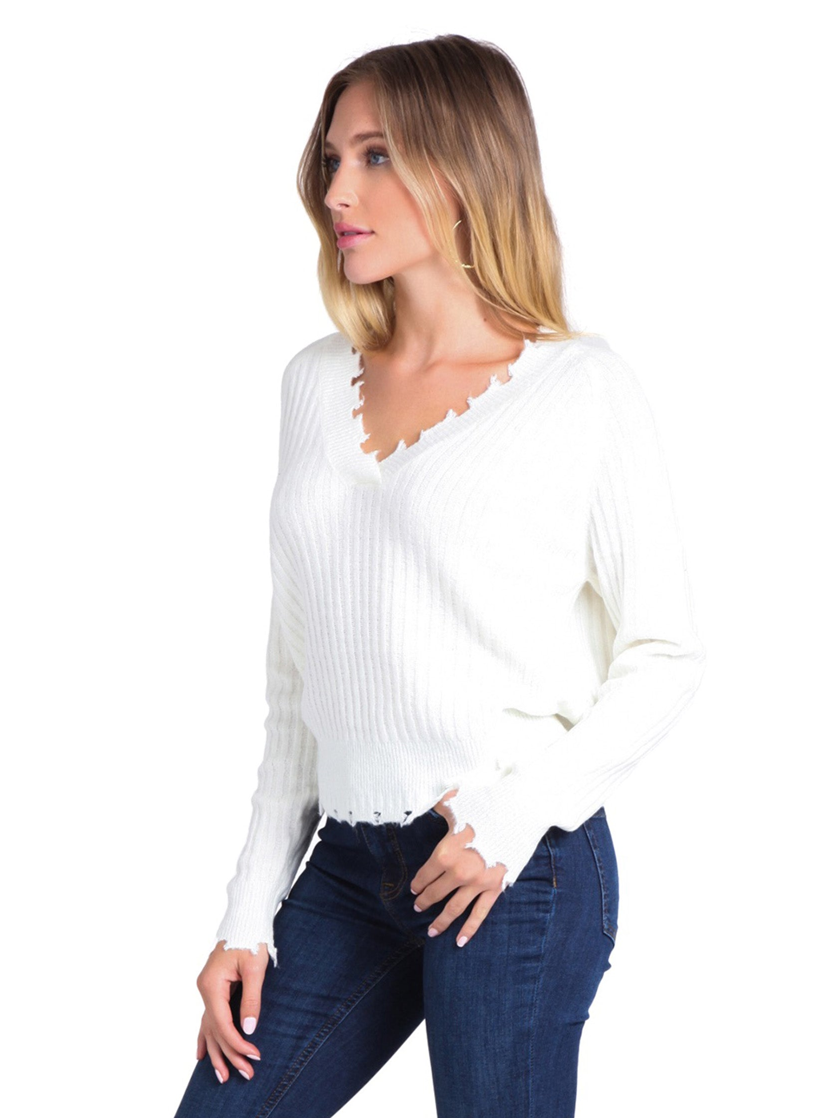 Women wearing a sweater rental from FashionPass called Distressed Ivory Sweater