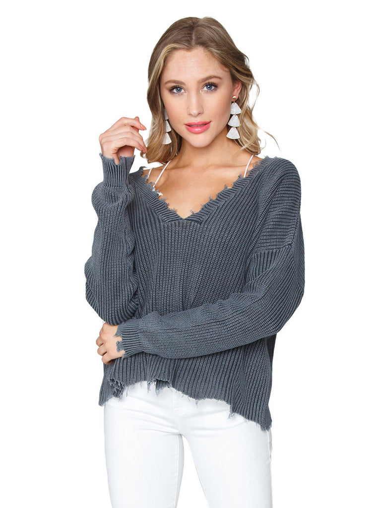 Woman wearing a sweater rental from FashionPass called Flare Sweater