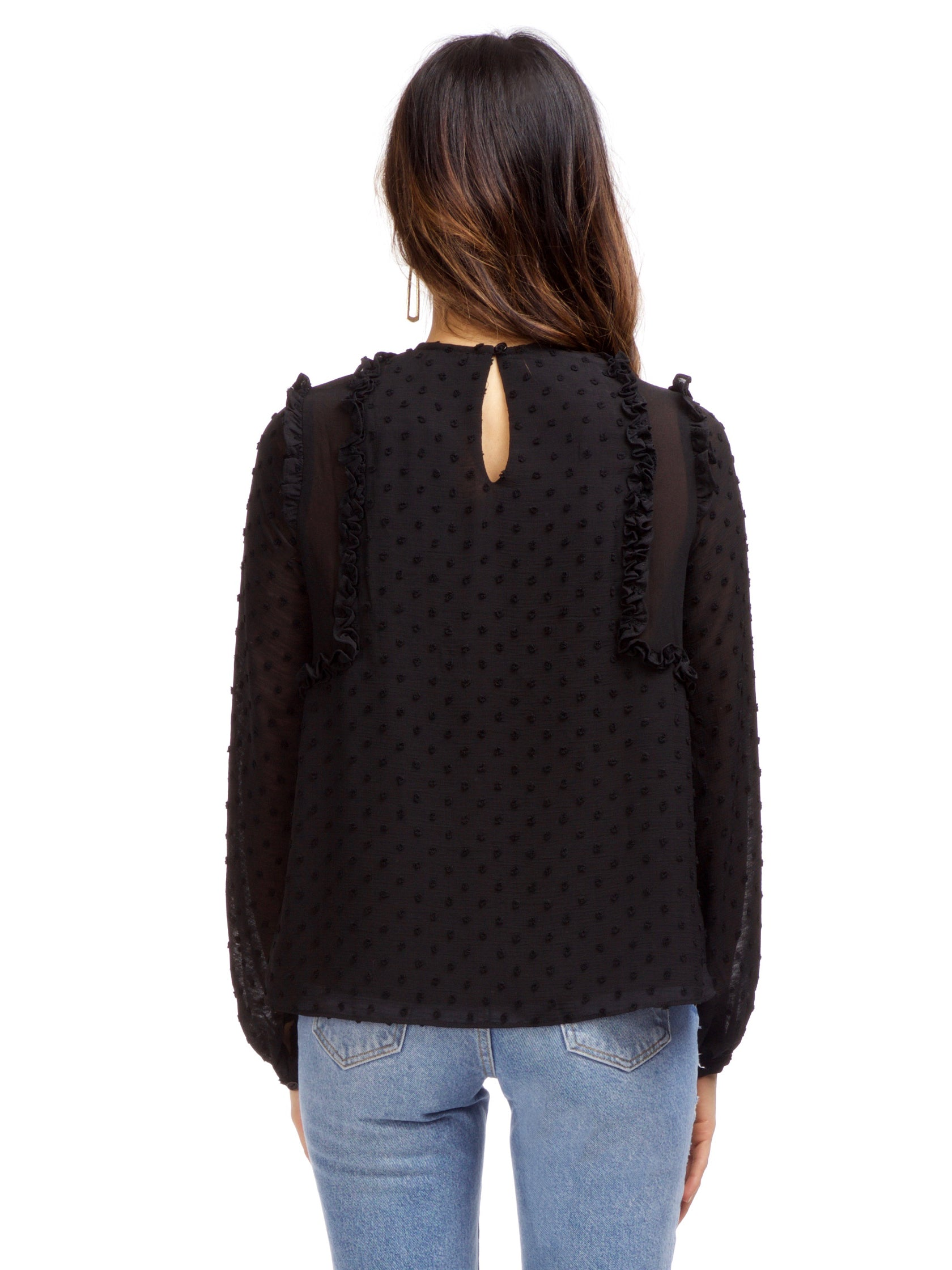 Women outfit in a top rental from Strut & Bolt called Dotted Ruffle Long Sleeve Top