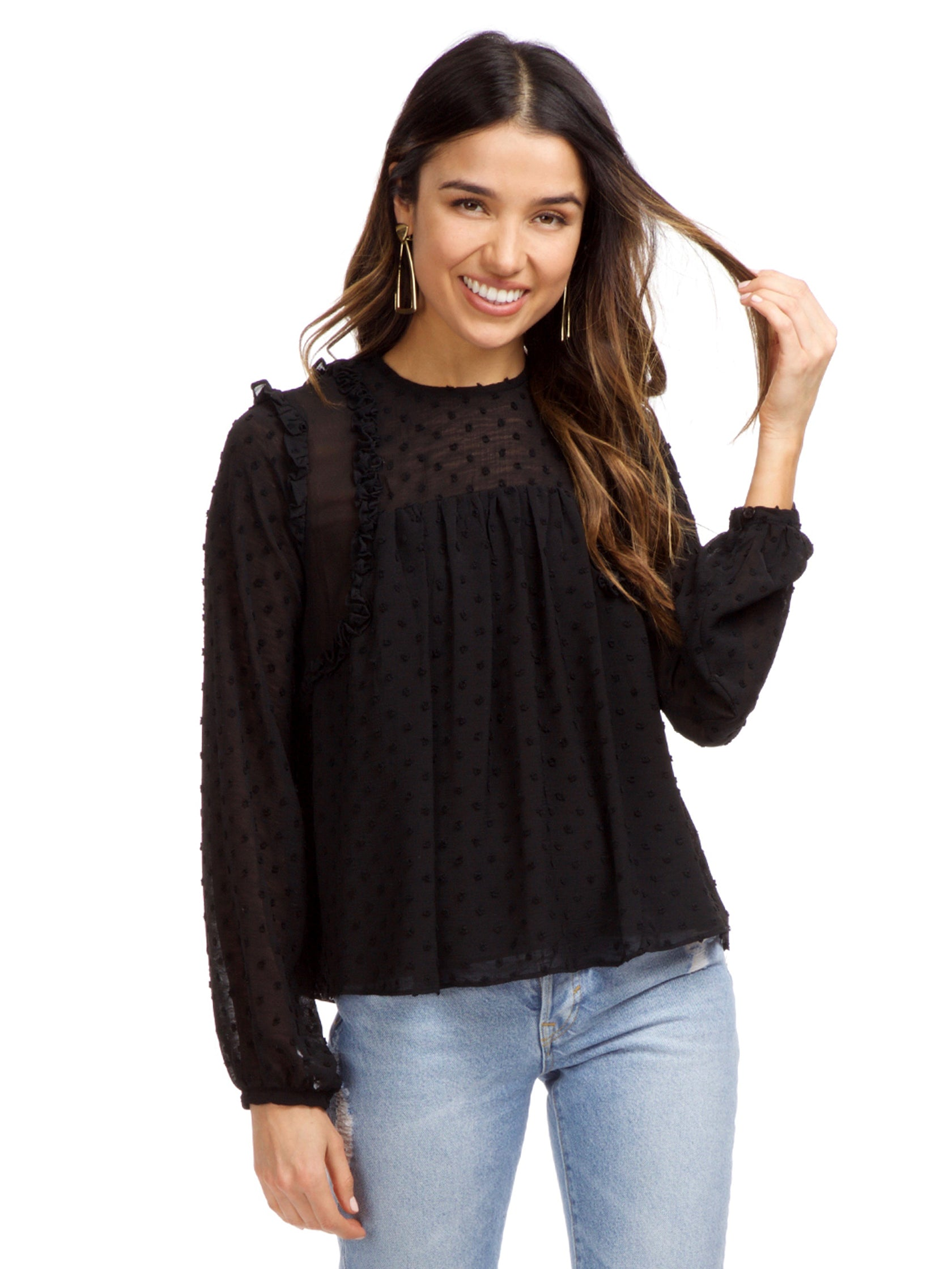 Woman wearing a top rental from Strut & Bolt called Dotted Ruffle Long Sleeve Top
