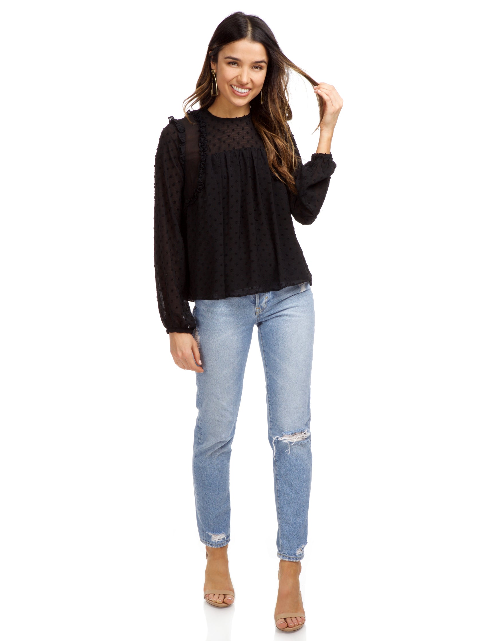 Girl wearing a top rental from Strut & Bolt called Dotted Ruffle Long Sleeve Top