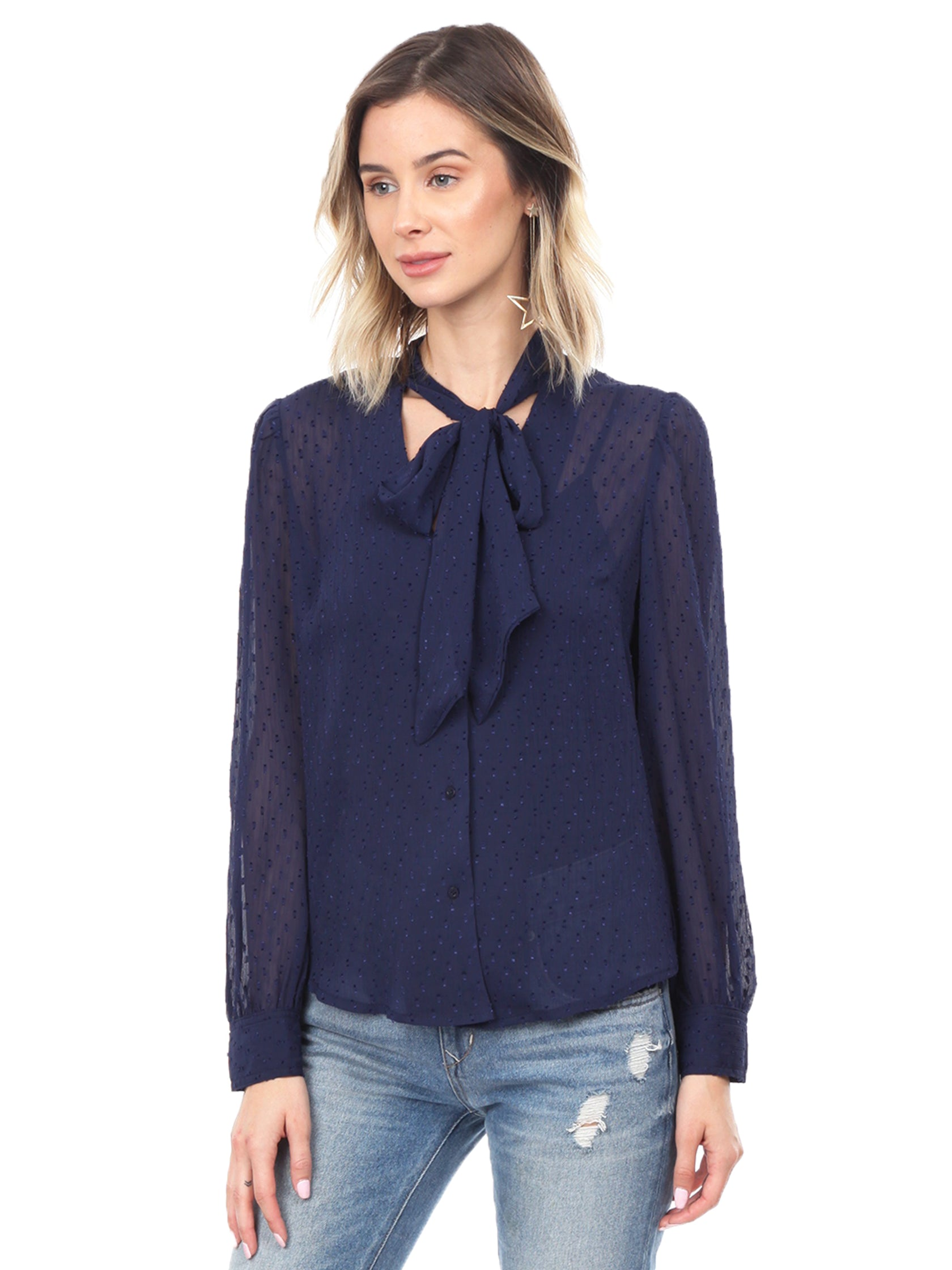 Woman wearing a top rental from FashionPass called Dottie Long Sleeve Blouse