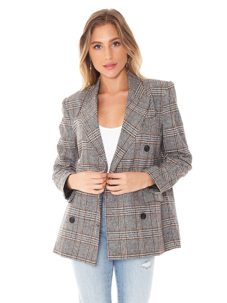 Women wearing a blazer rental from ASTR called Shannon Dress