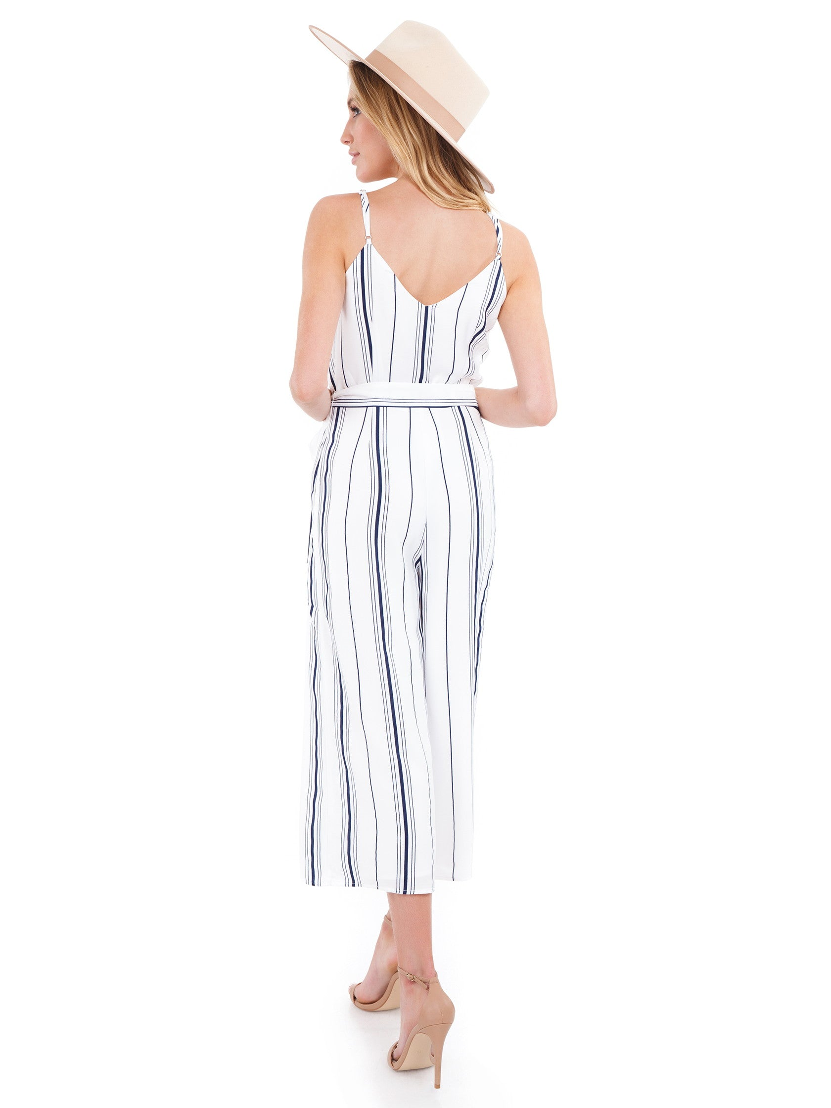 Women wearing a jumpsuit rental from J.O.A. called Double V Neck Cropped Jumpsuit