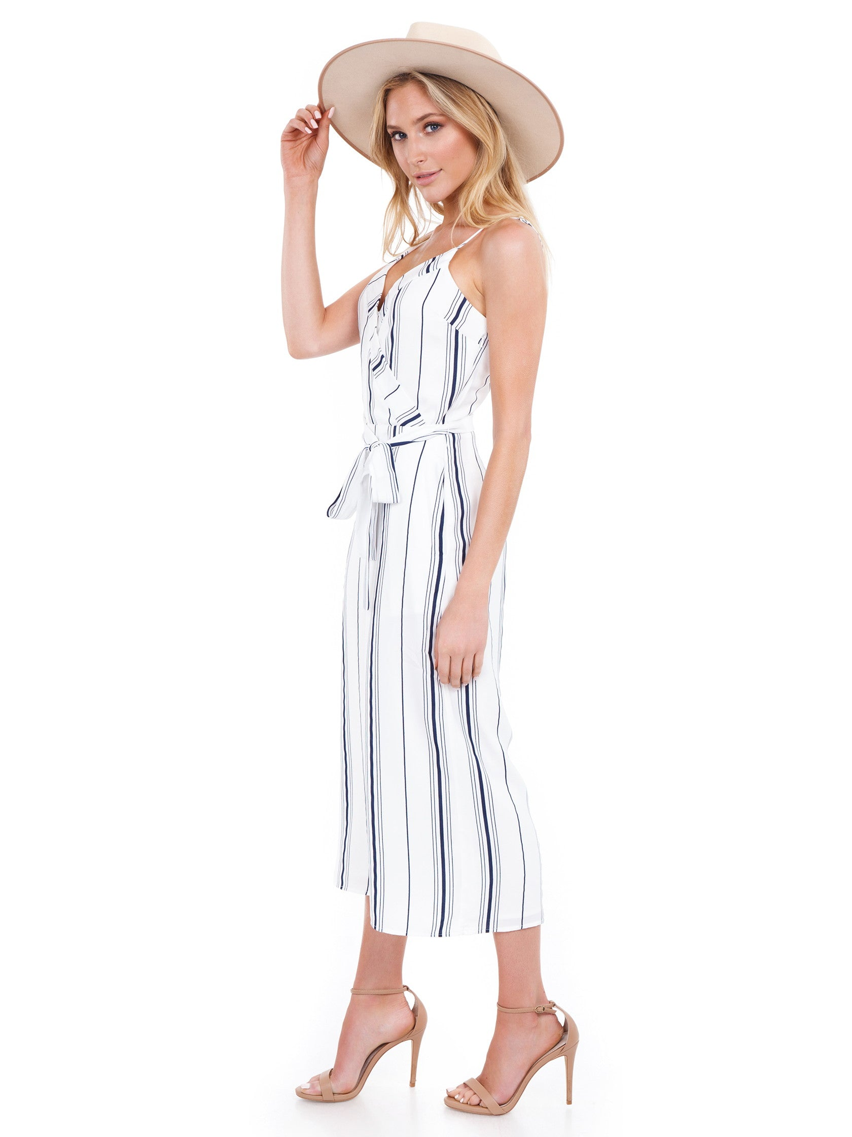 Woman wearing a jumpsuit rental from J.O.A. called Double V Neck Cropped Jumpsuit