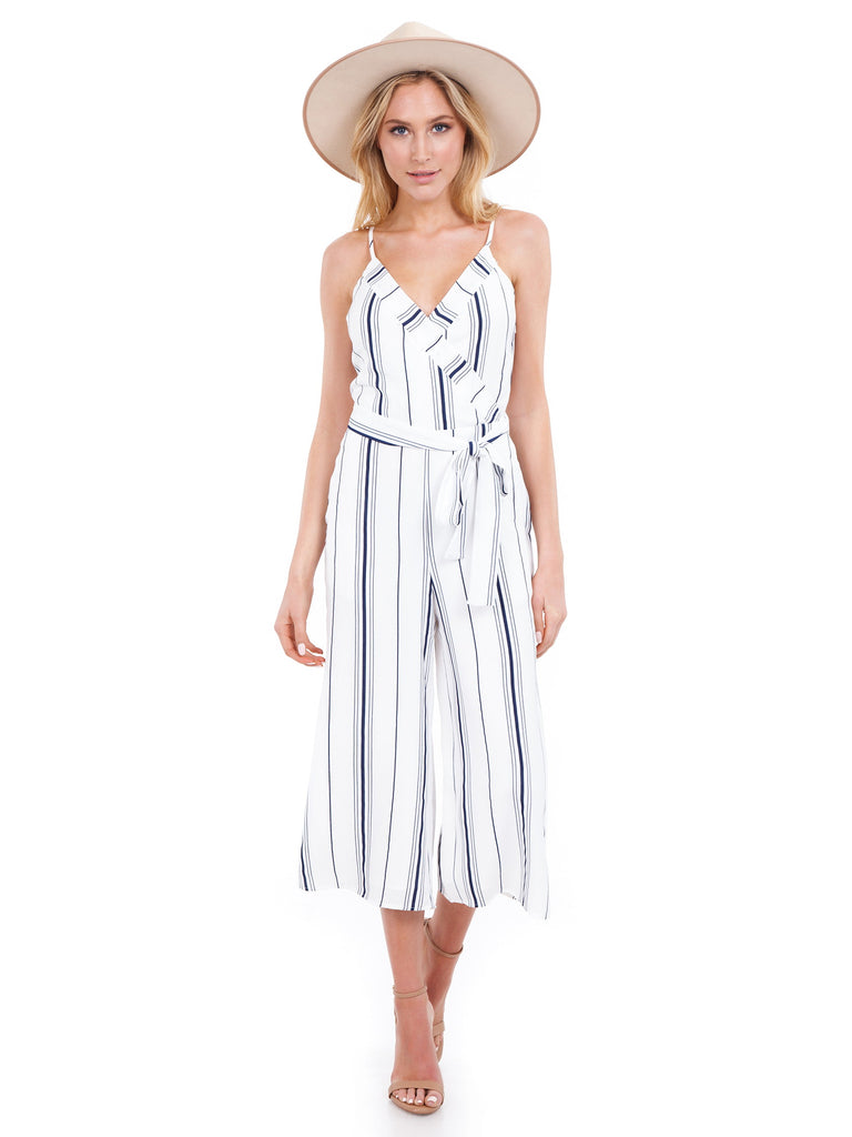 Women wearing a jumpsuit rental from J.O.A. called Ruffle Cold Shoulder Dress