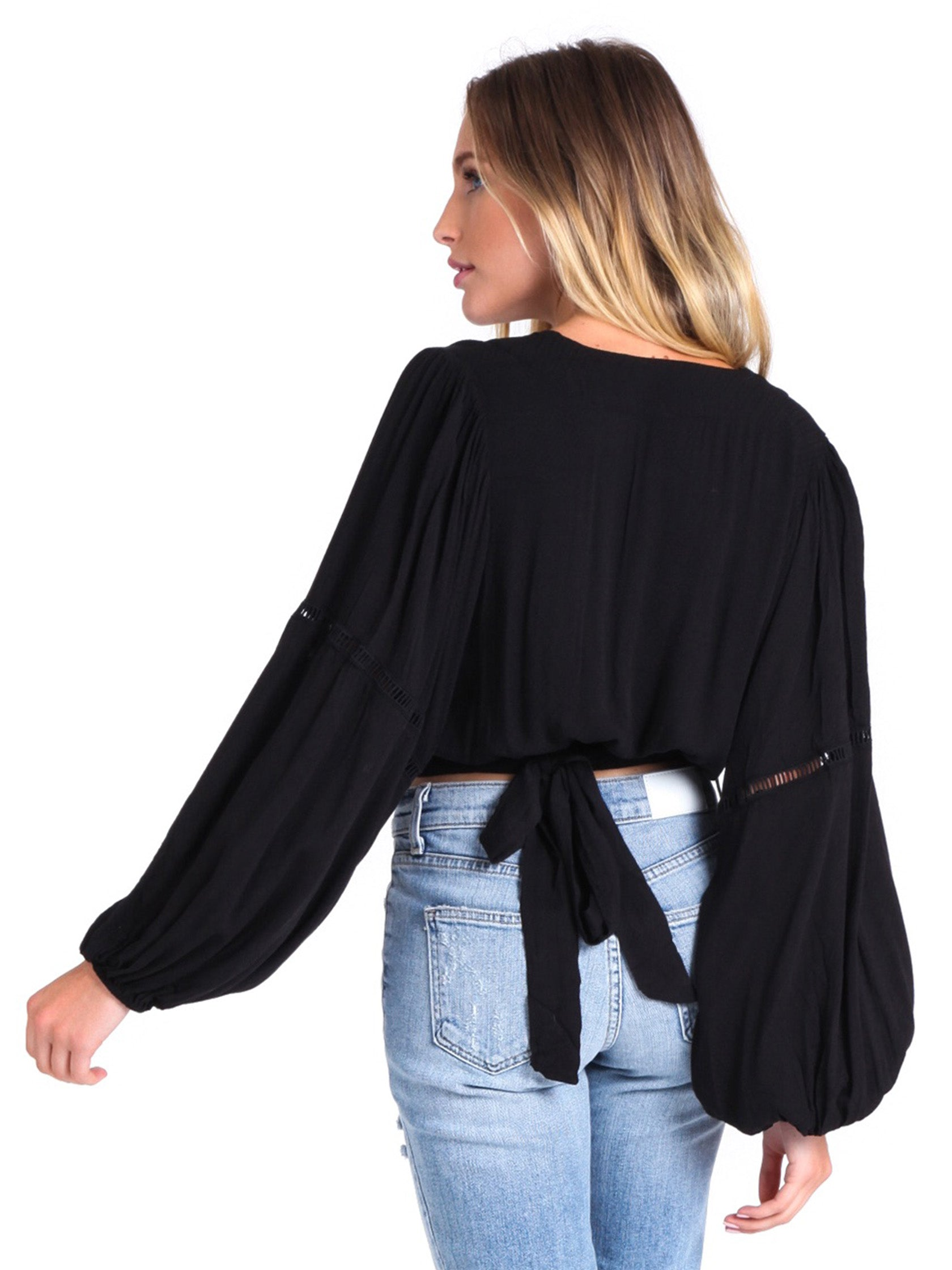 Women outfit in a top rental from Free People called Dream Girl Wrap Top