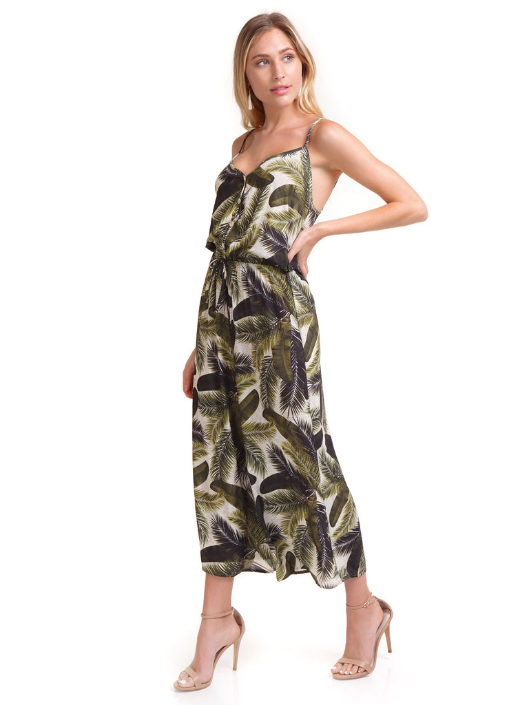 Woman wearing a jumpsuit rental from Show Me Your Mumu called Megan Jumpsuit