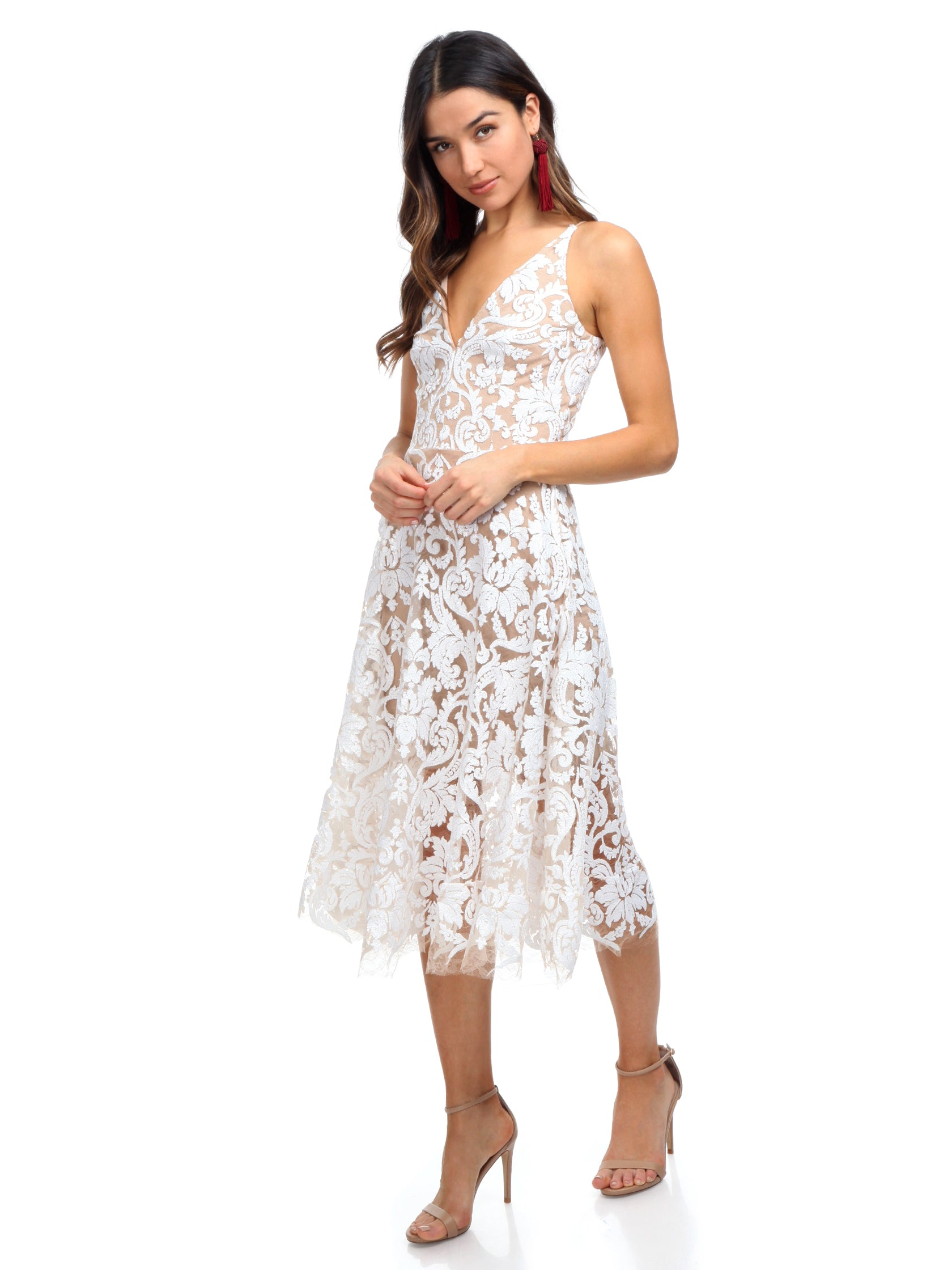 60331165bce Woman wearing a dress rental from Dress the Population called Blair Sequin  Lace Midi