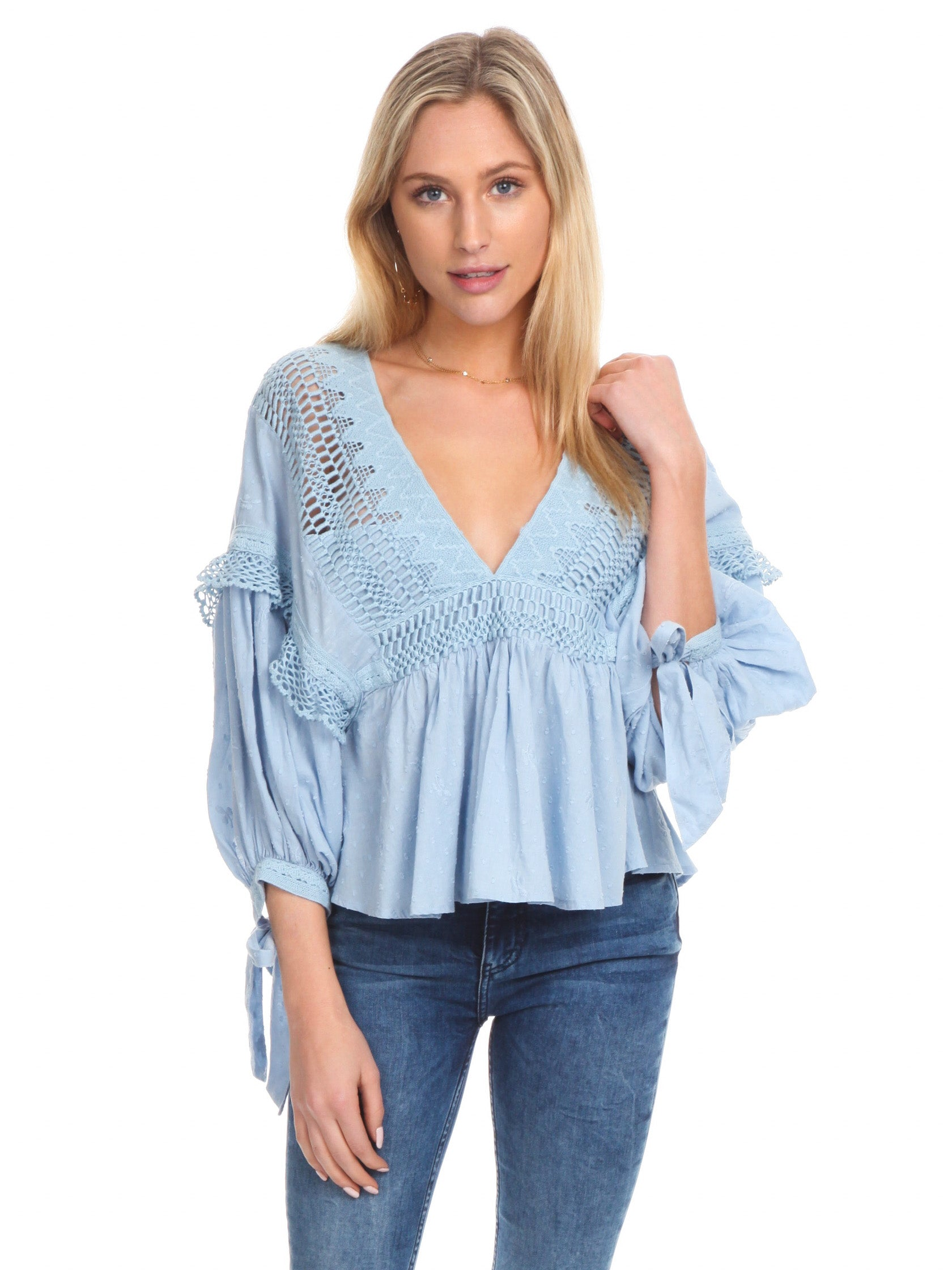 Woman wearing a top rental from Free People called Drive You Mad Blouse
