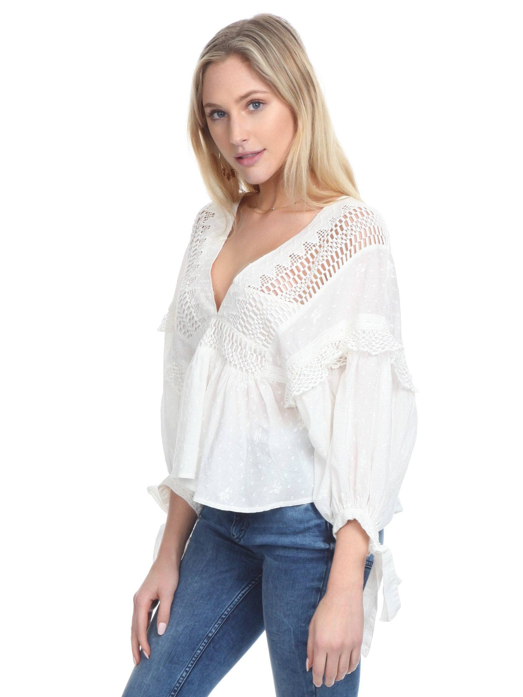 Women wearing a top rental from Free People called Drive You Mad Blouse