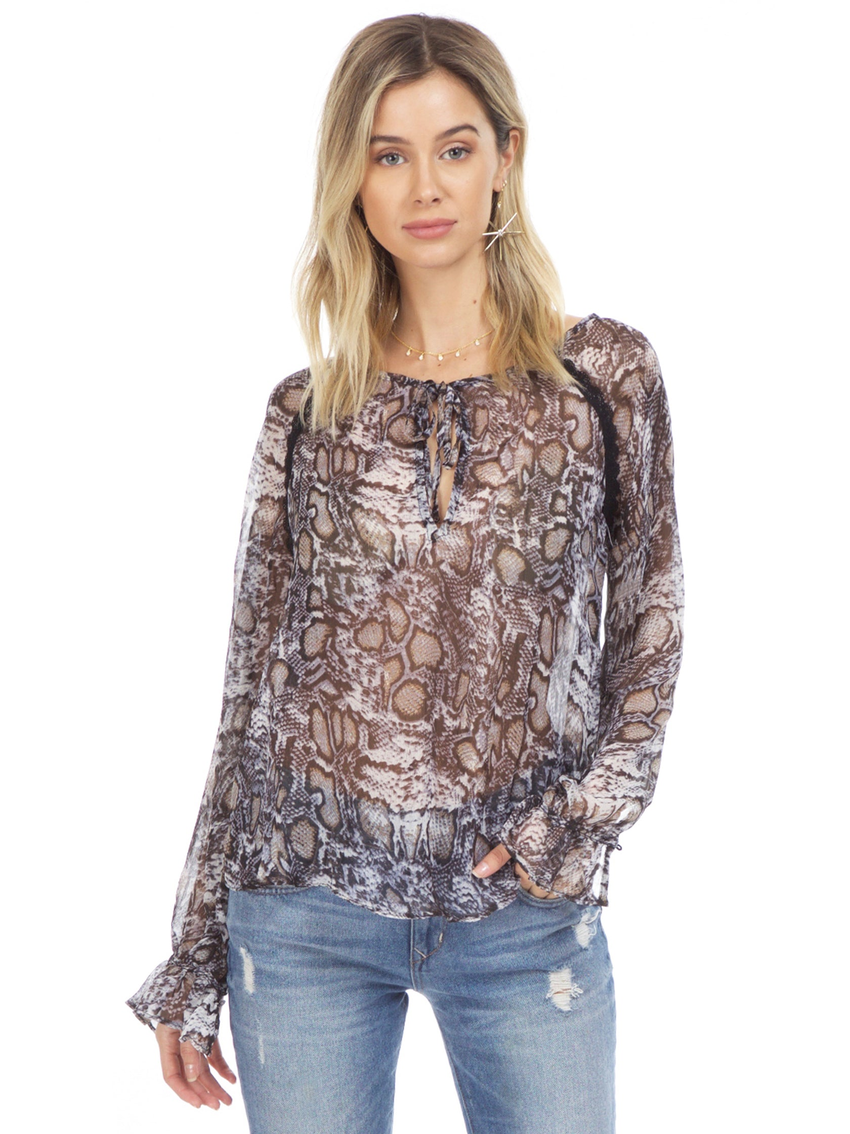 Woman wearing a top rental from WYLDR called Dust In The Wind Blouse