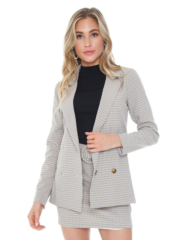 Woman wearing a blazer rental from Charlie Holiday called Cheri Bodysuit