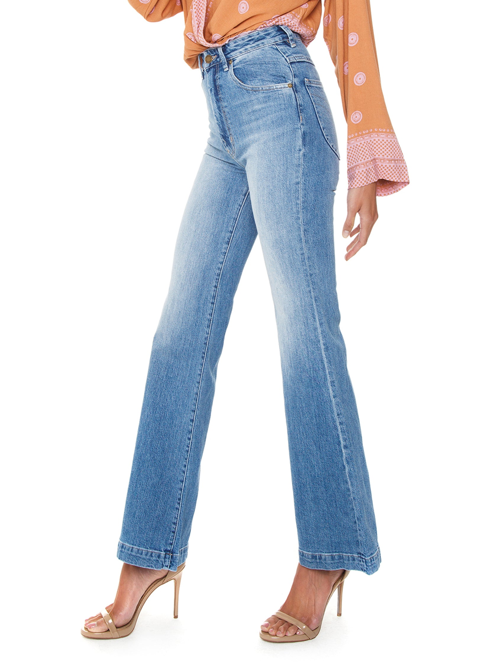 Women wearing a denim rental from ROLLAS called Eastcoast Flare
