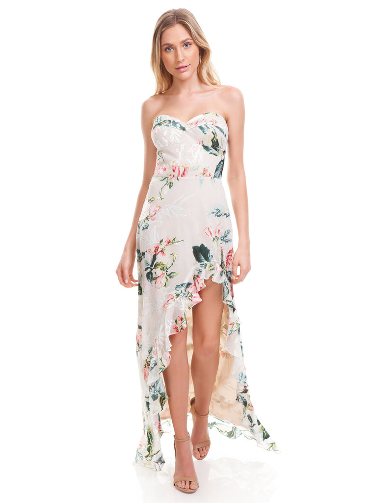 Women outfit in a dress rental from Amanda Uprichard called Gwyneth Ruffle Maxi Dress