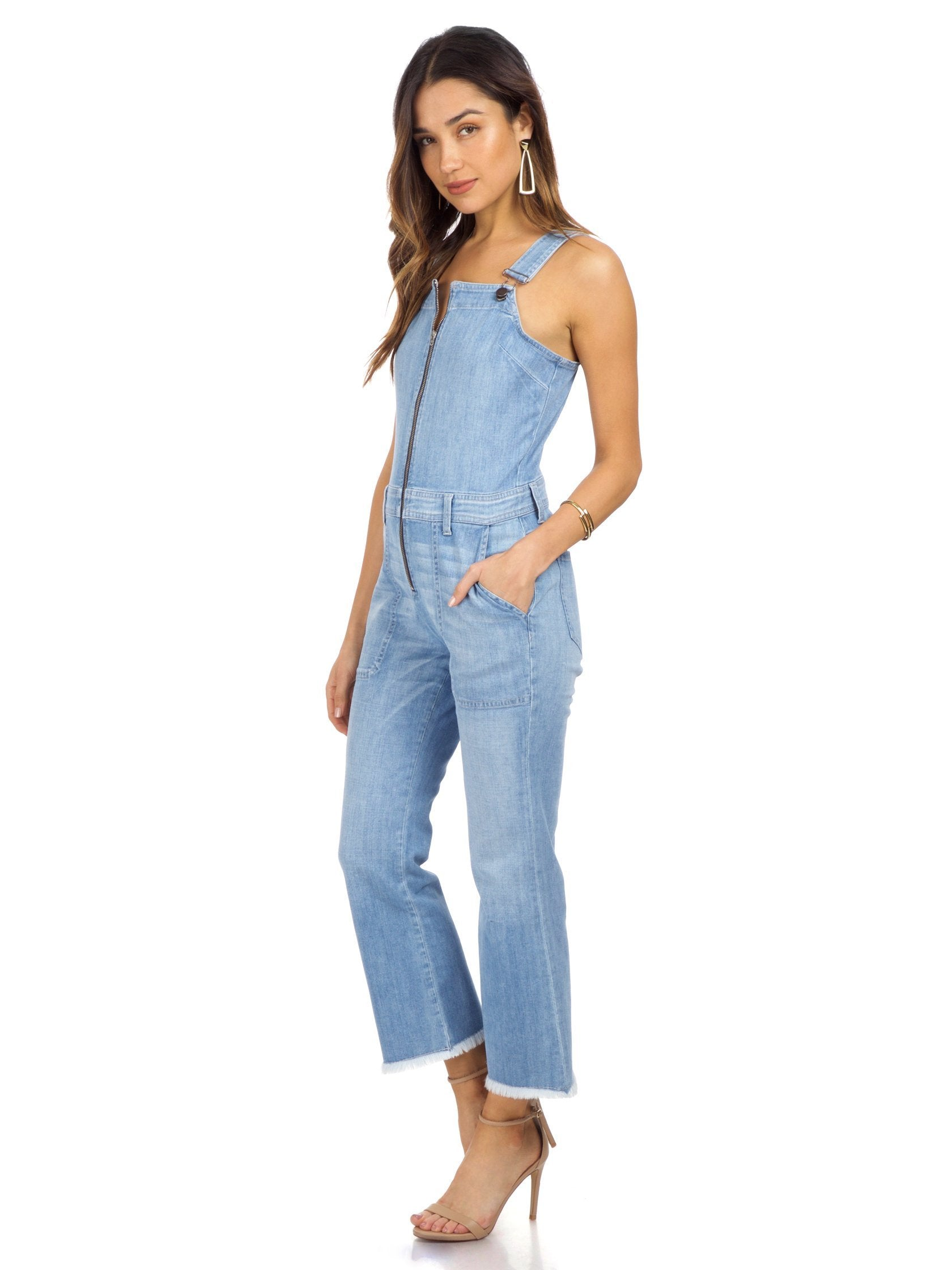 Woman wearing a jumpsuit rental from ei8ht dreams called Flare Overall