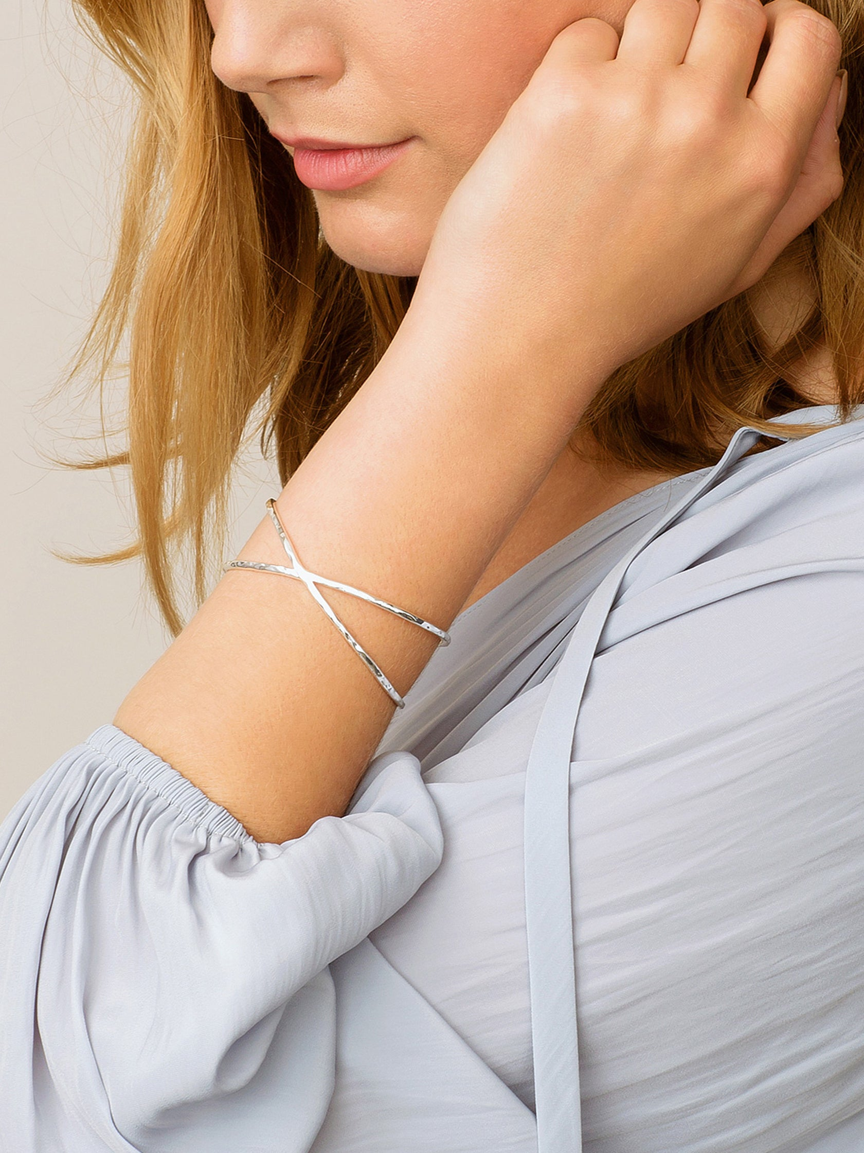 Girl wearing a bracelet rental from Gorjana called Elea Cuff