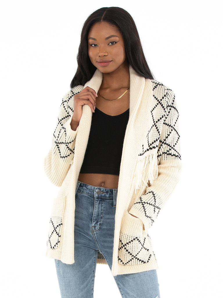 Girl wearing a cardigan rental from Line & Dot called Angel Eyes Jacket