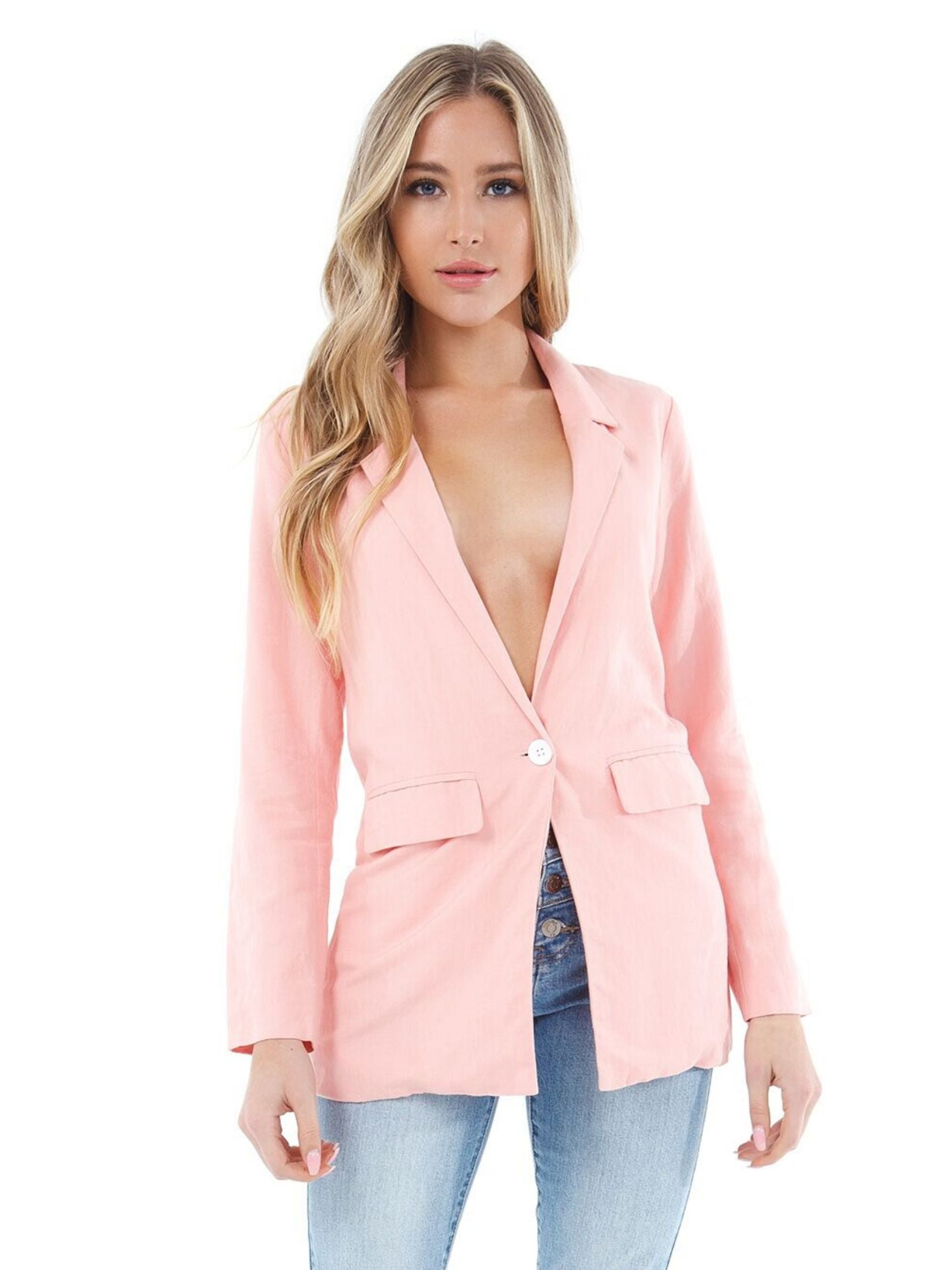 Woman wearing a jacket rental from Charlie Holiday called Elle Linen Blazer