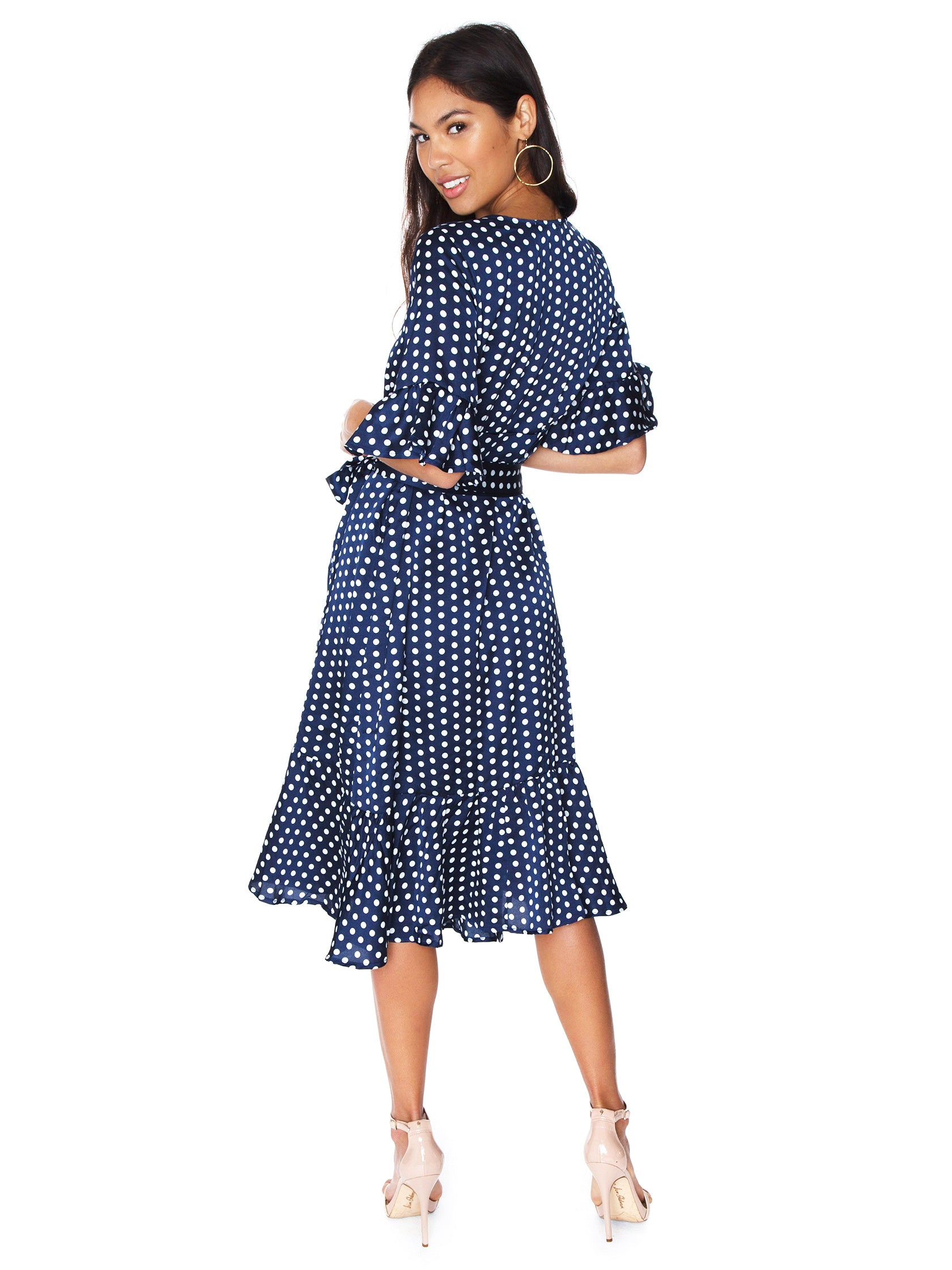 Women wearing a dress rental from Line & Dot called Elsie Ruffle Wrap Dress