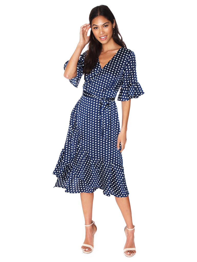 Woman wearing a dress rental from Line & Dot called Monica Maxi Dress