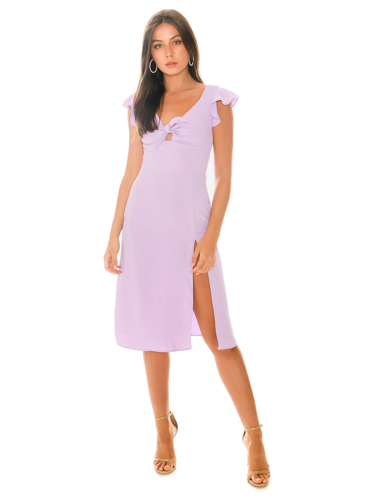 Women outfit in a dress rental from Amanda Uprichard X PYRMD called Elsie Ruffle Wrap Dress