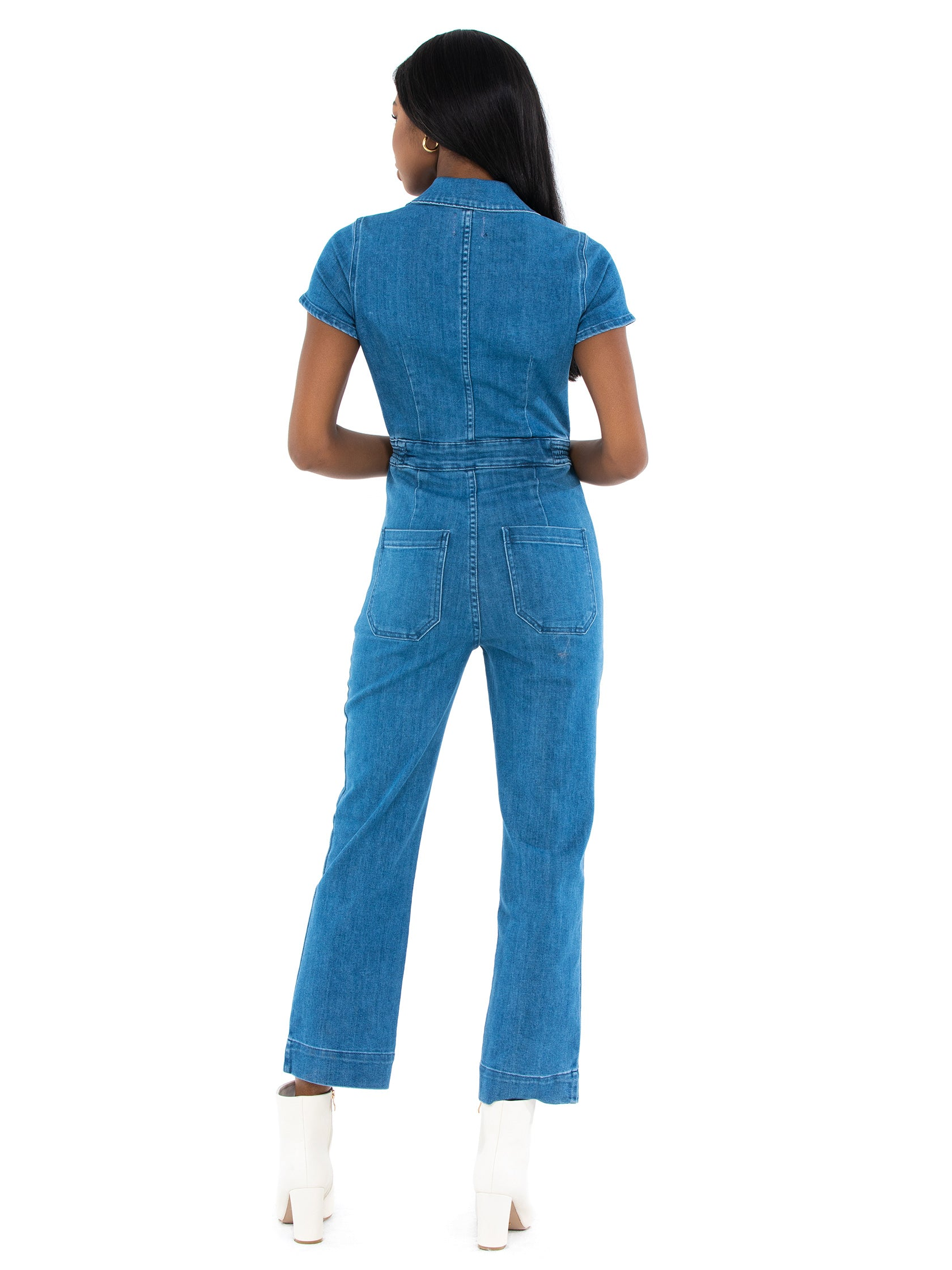 Women wearing a jumpsuit rental from Show Me Your Mumu called Emery Jumpsuit