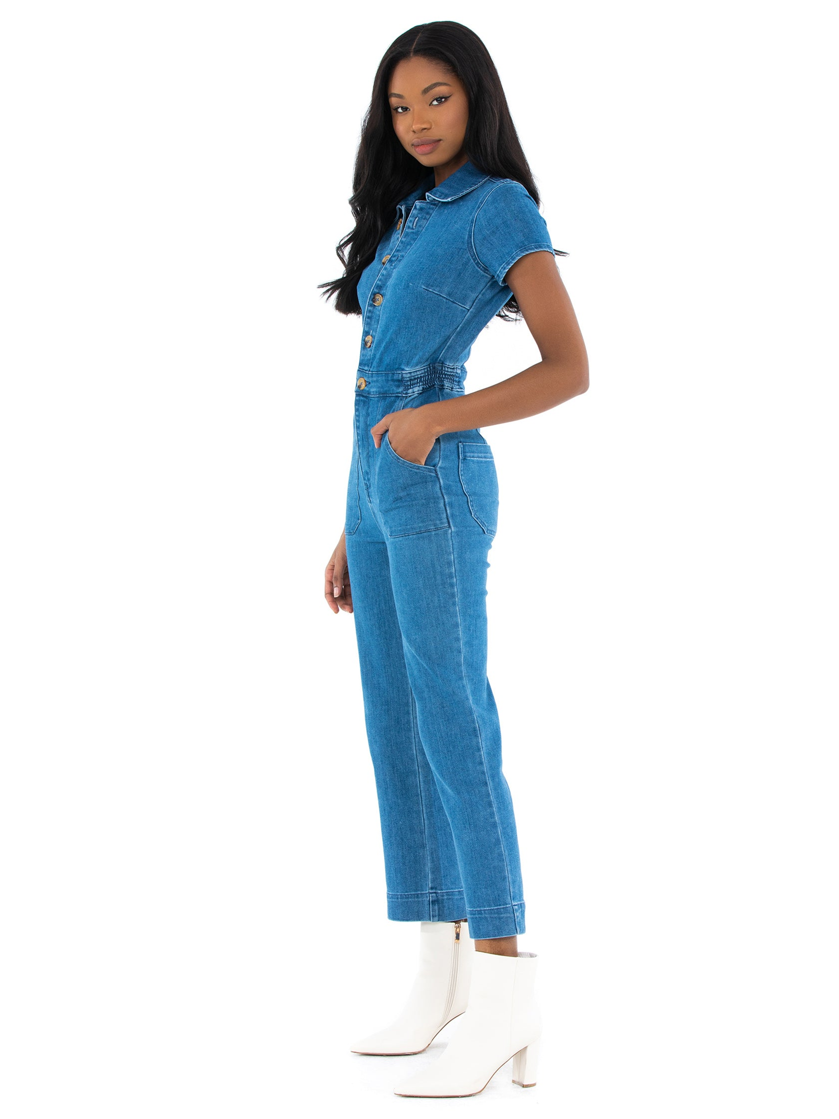 Woman wearing a jumpsuit rental from Show Me Your Mumu called Emery Jumpsuit
