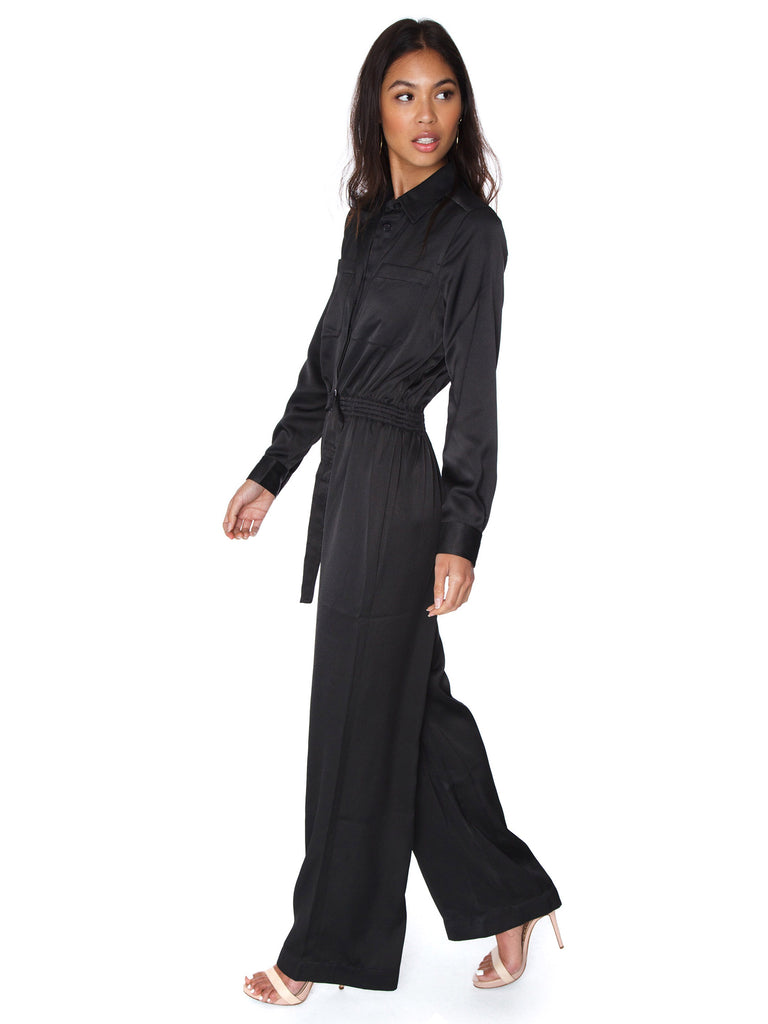 Woman wearing a jumpsuit rental from French Connection called Whisper Light Sweetheart Dress
