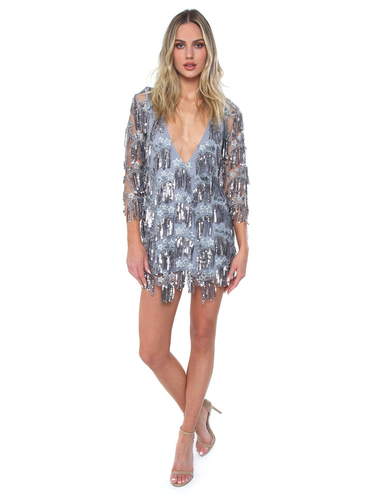 Women wearing a dress rental from For Love & Lemons called Showtime Mini Dress