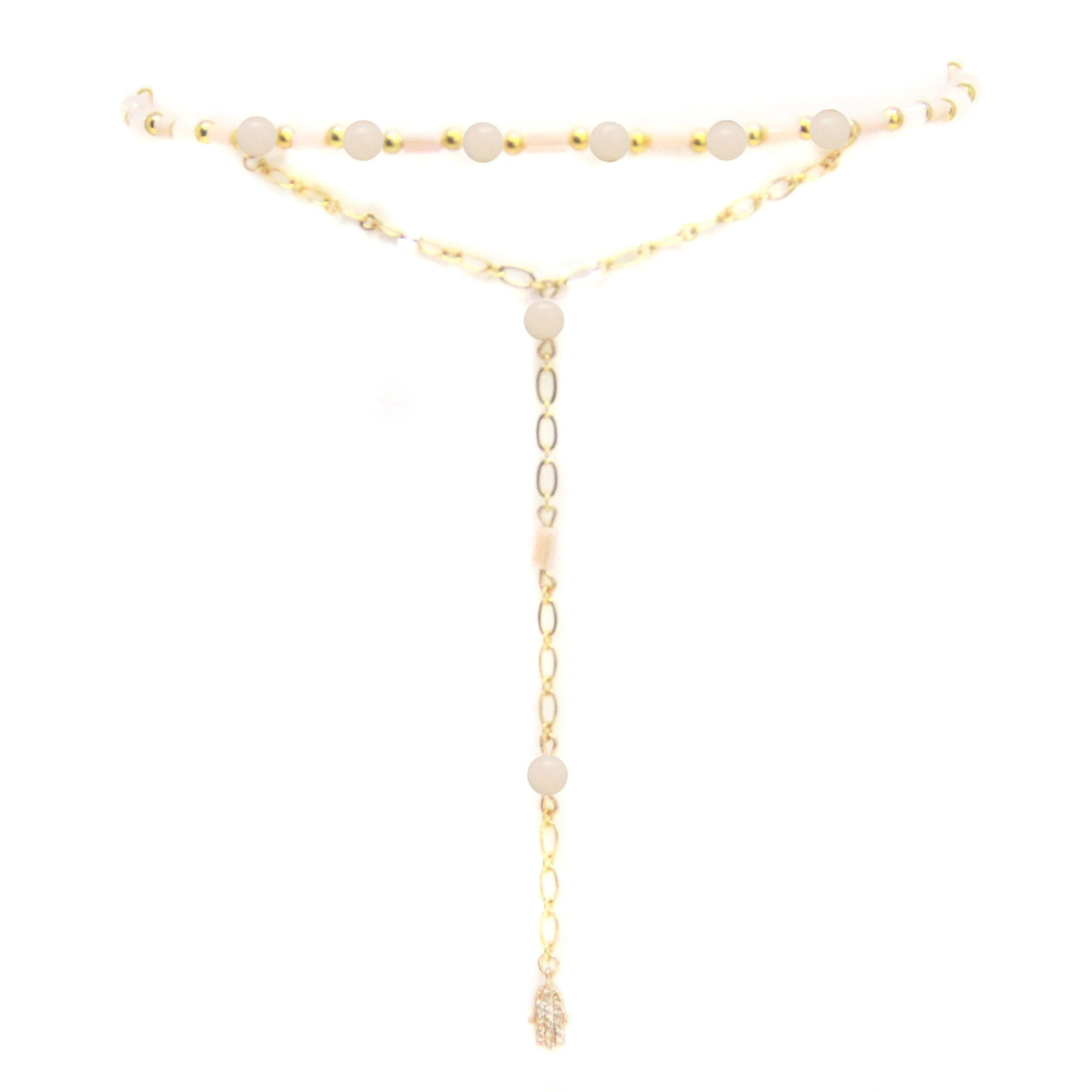 Women outfit in a choker rental from Ettika called Love Me Lariat In Pink And Gold With Hamsa