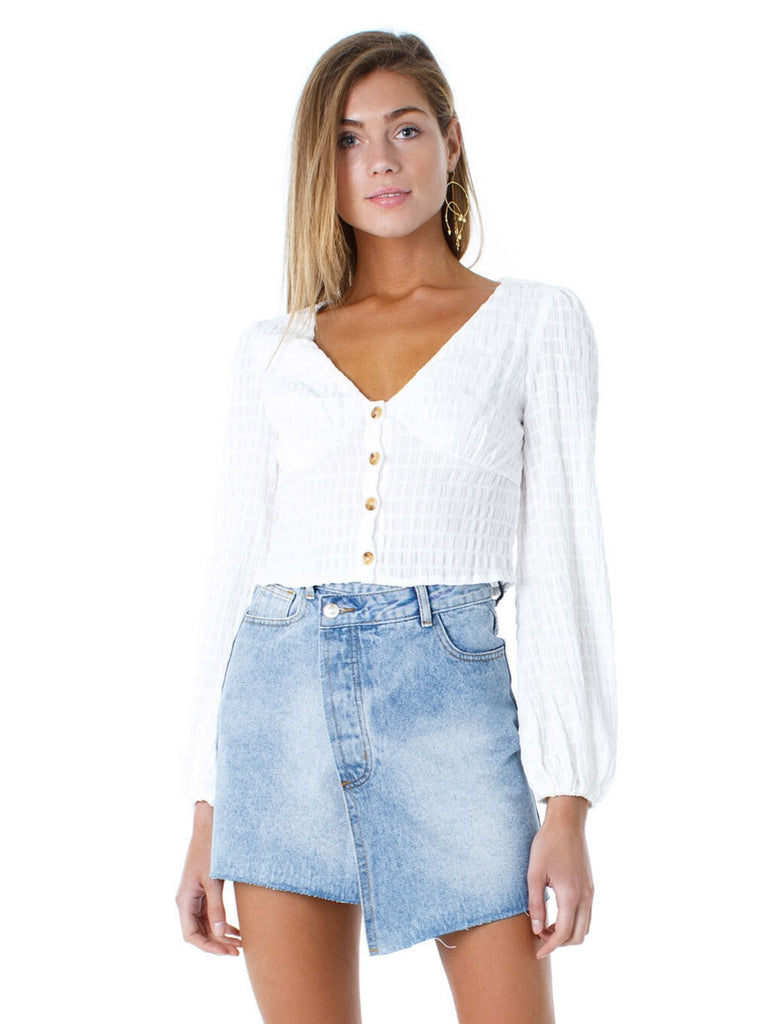 Woman wearing a top rental from Line & Dot called Jasper Fringe Sweater