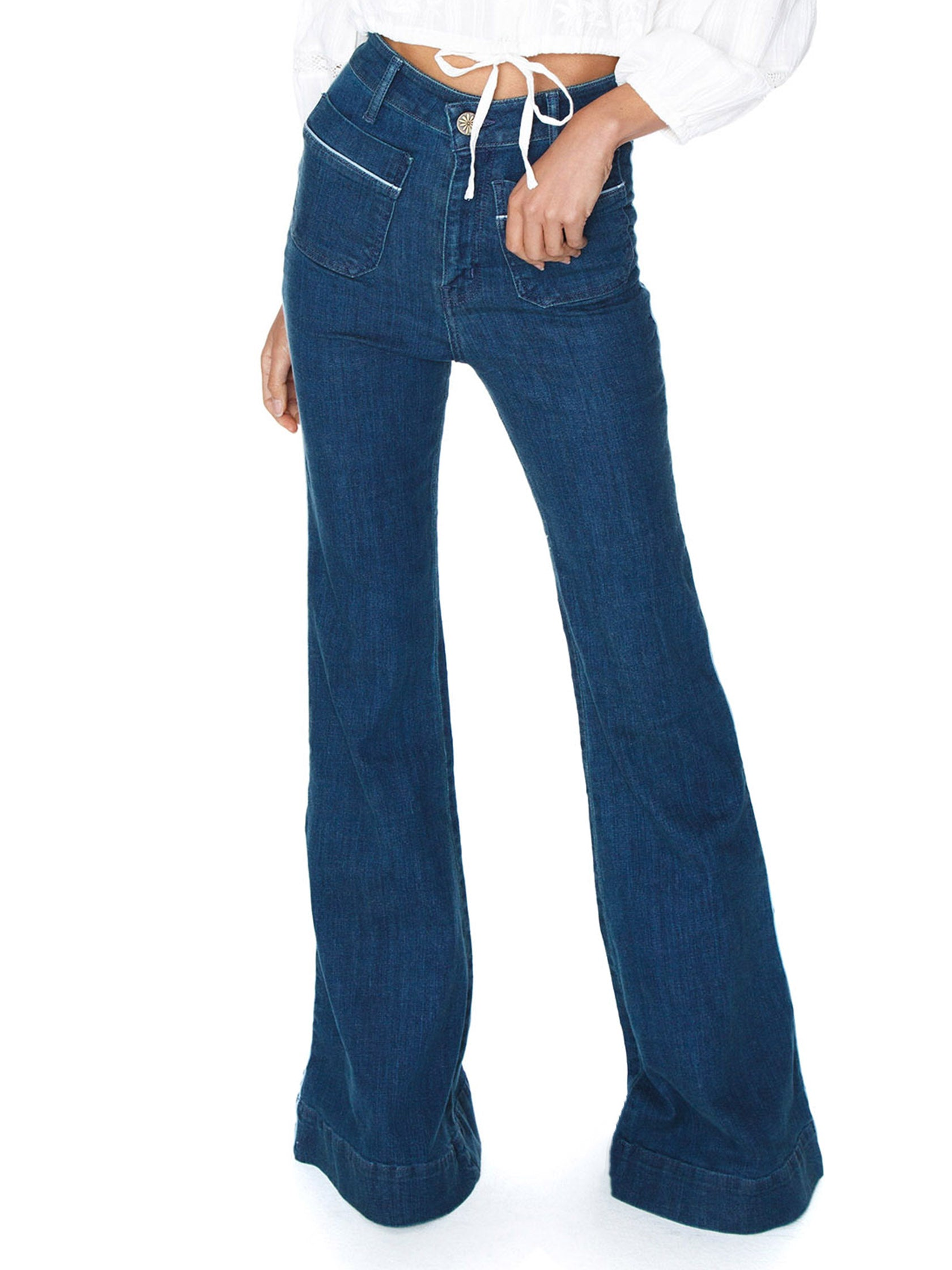 Woman wearing a denim rental from Show Me Your Mumu called Farrah Trouser Flare
