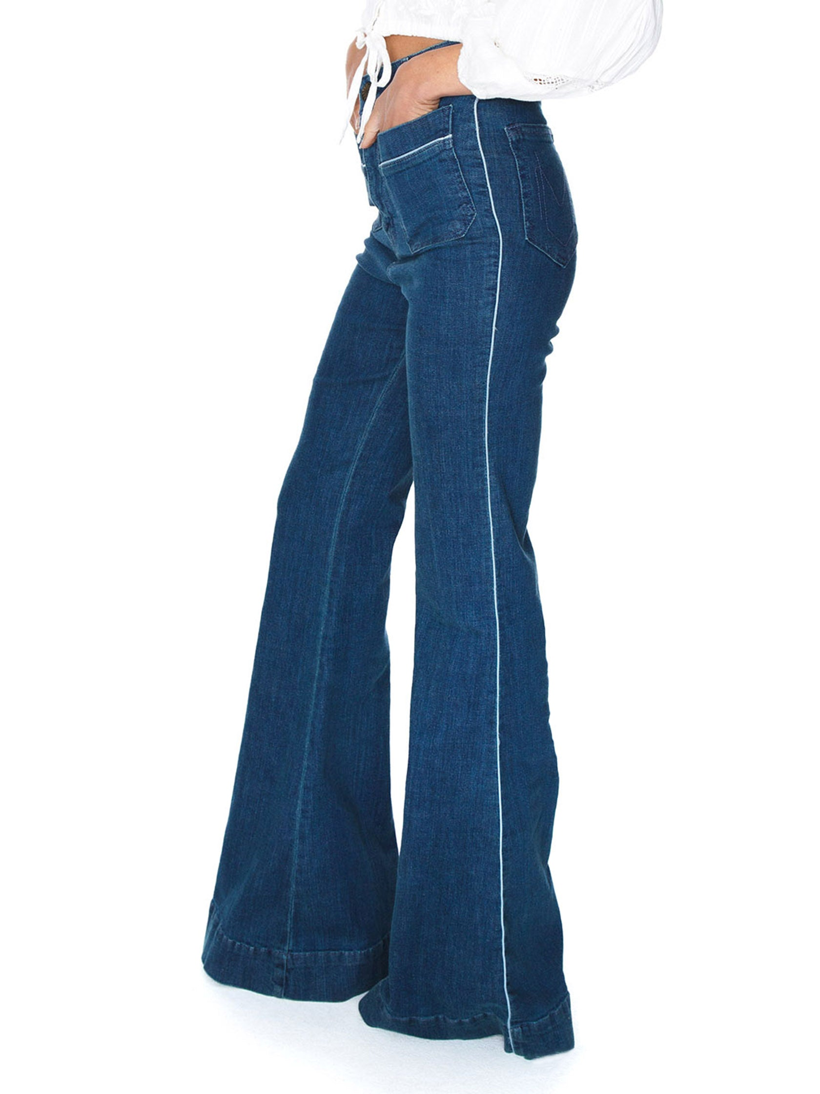 Women wearing a denim rental from Show Me Your Mumu called Farrah Trouser Flare