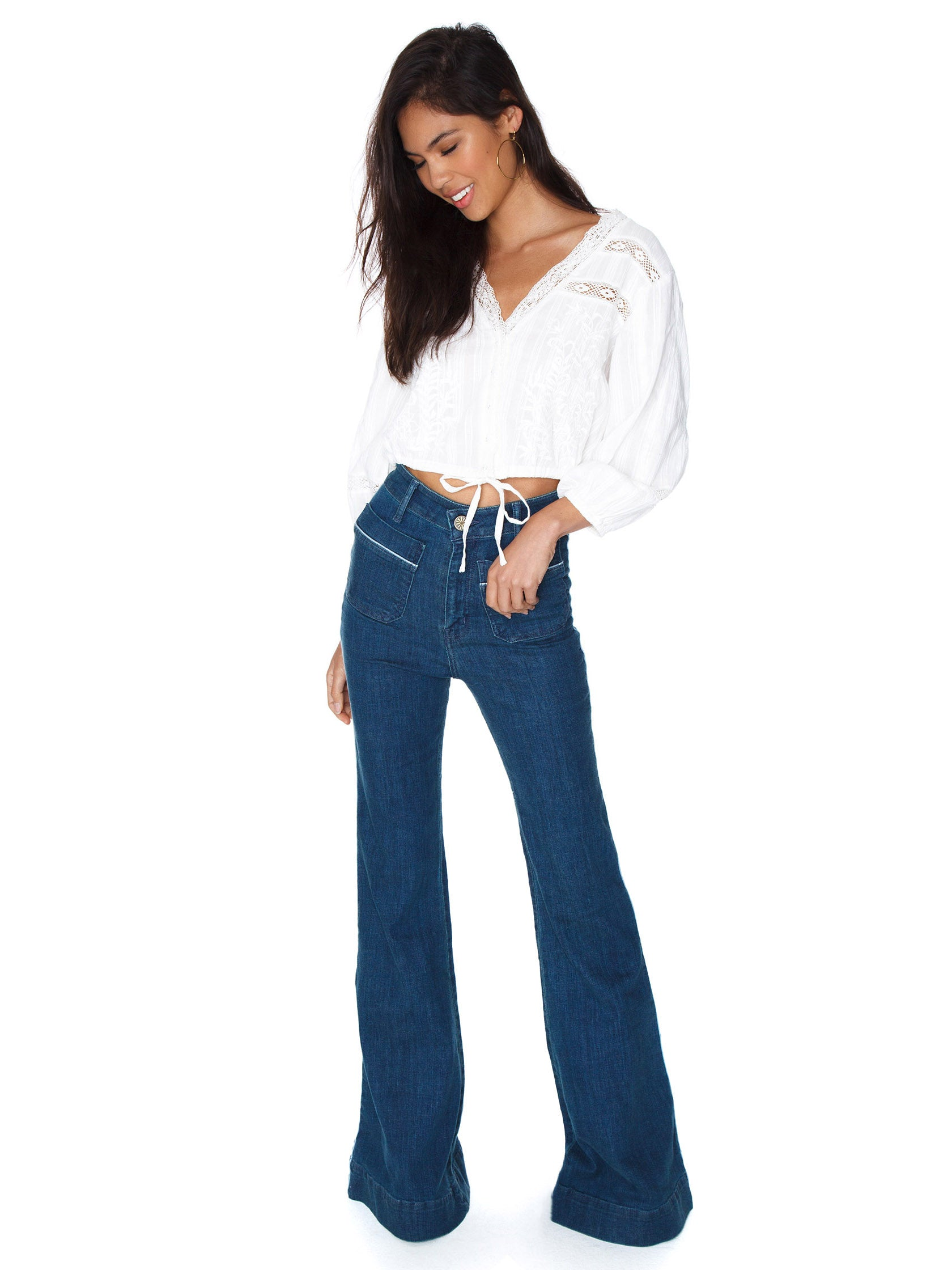 Girl wearing a denim rental from Show Me Your Mumu called Farrah Trouser Flare