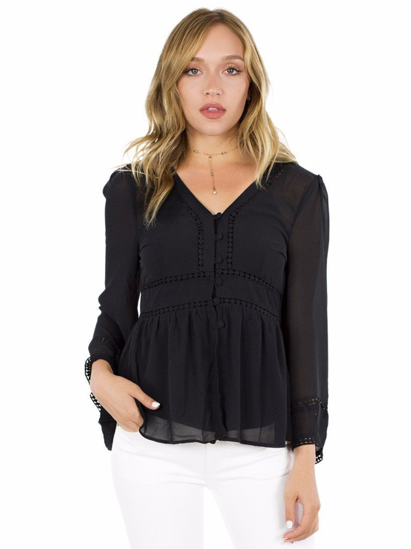 Woman wearing a top rental from FashionPass called All Buttoned Up Shirt