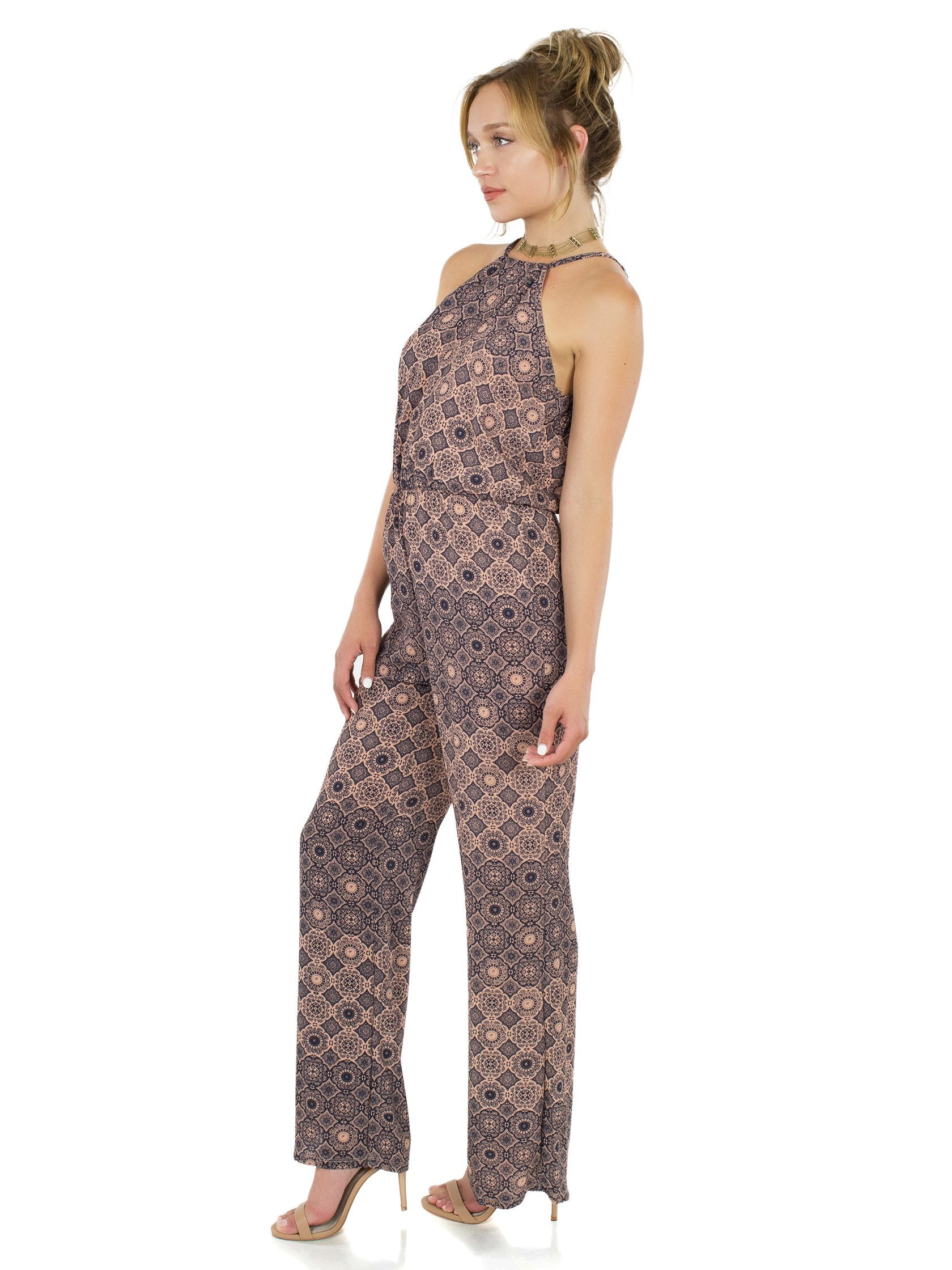 Woman wearing a jumpsuit rental from FashionPass called Desert Sky Jumpsuit